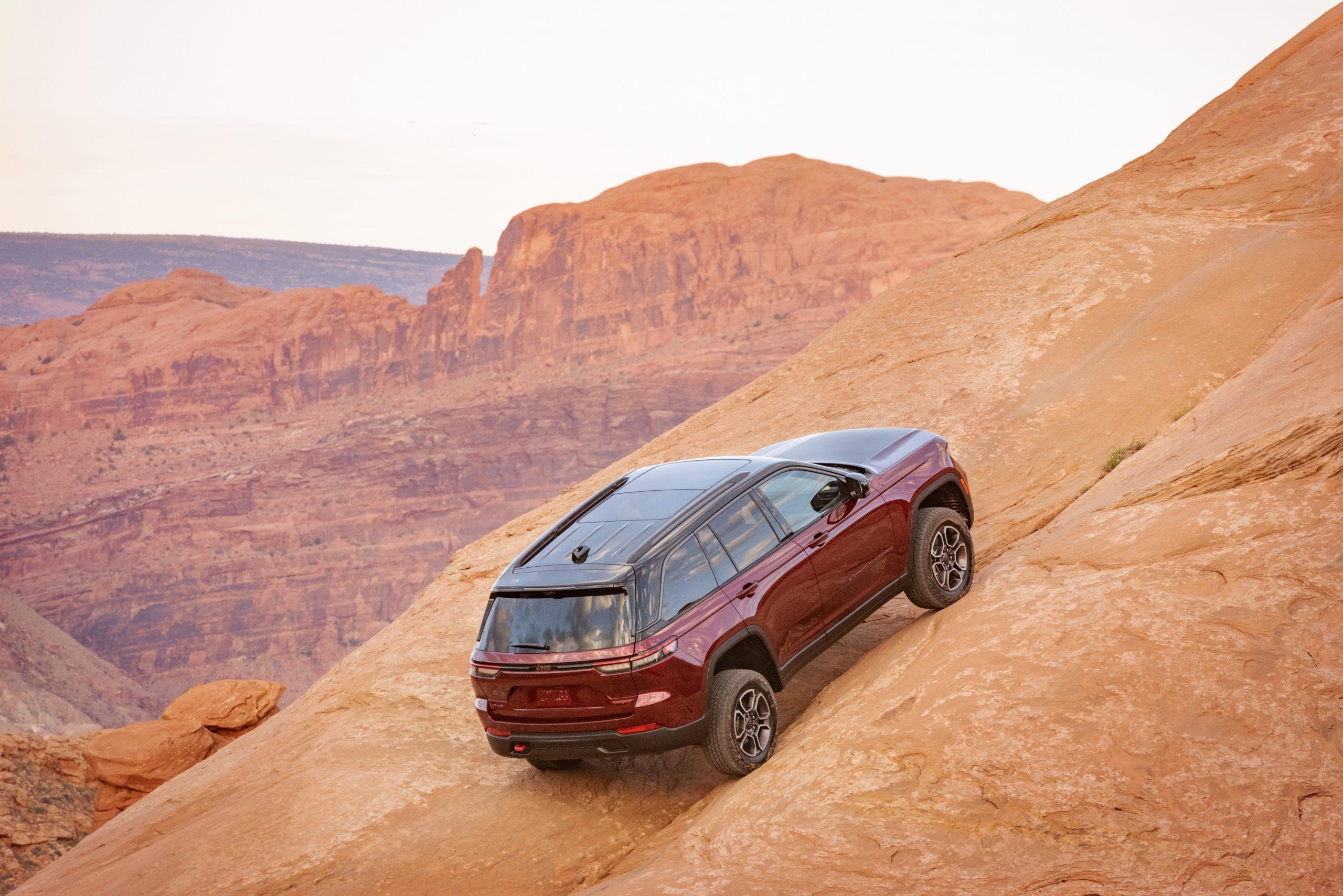 2022 Jeep Grand Cherokee Trailhawk climbing rock face
