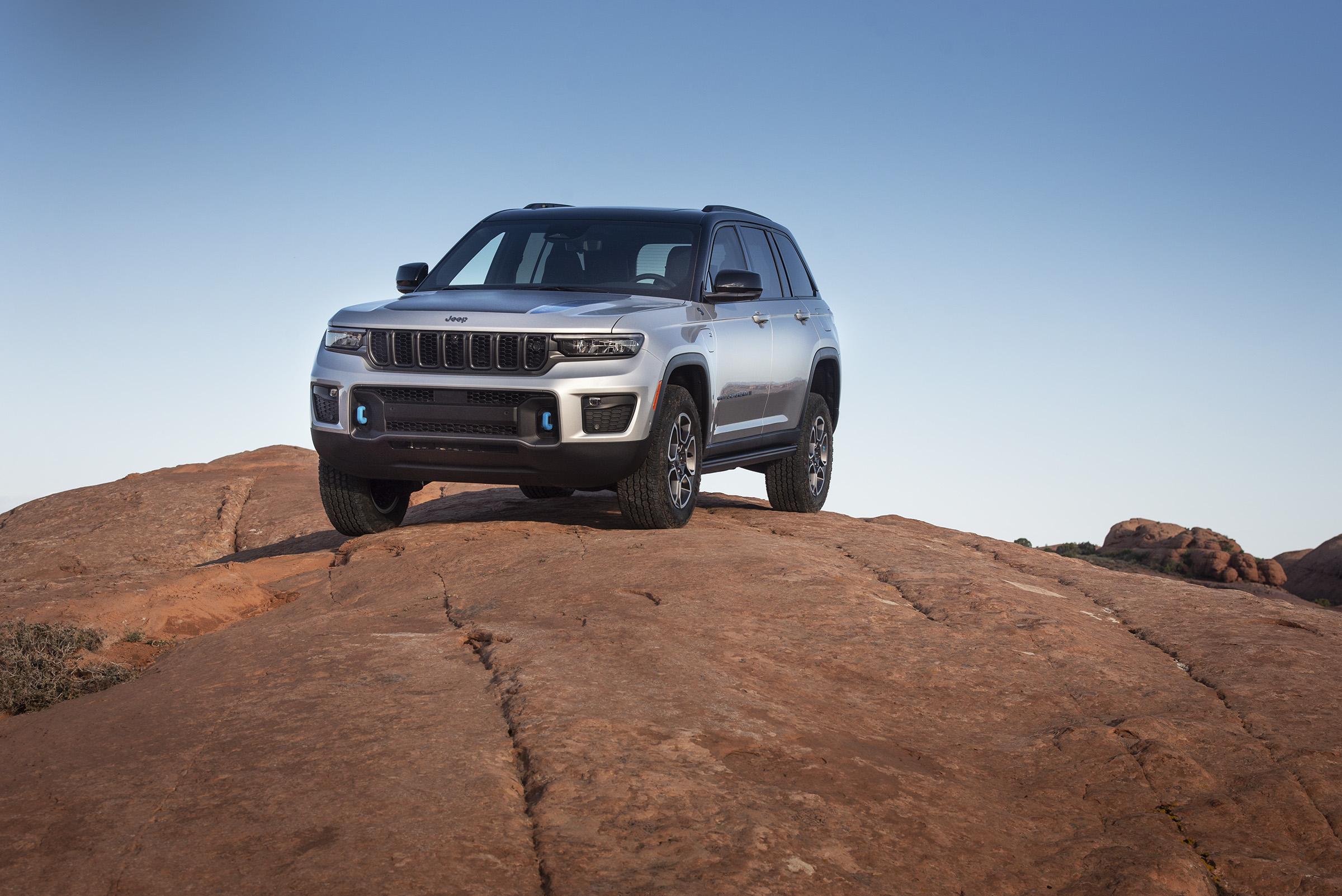 2022 Jeep Grand Cherokee Trailhawk 4xe front three quarter on rocks