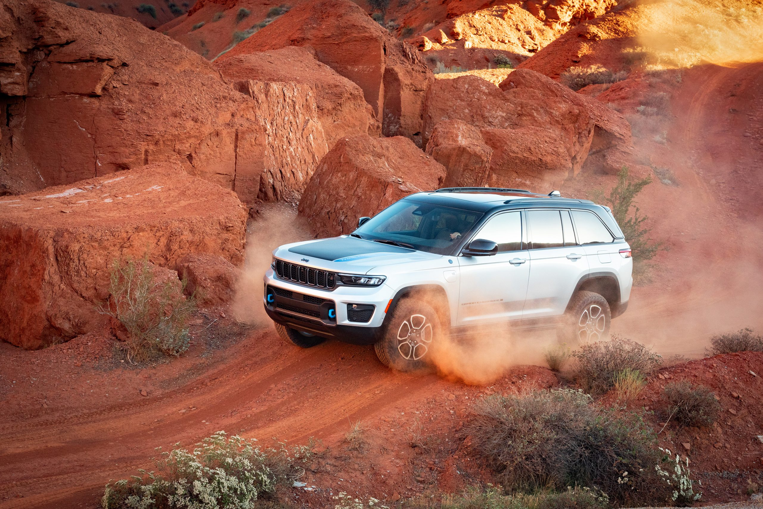 2022 Jeep Grand Cherokee Trailhawk 4xe side profile over jump