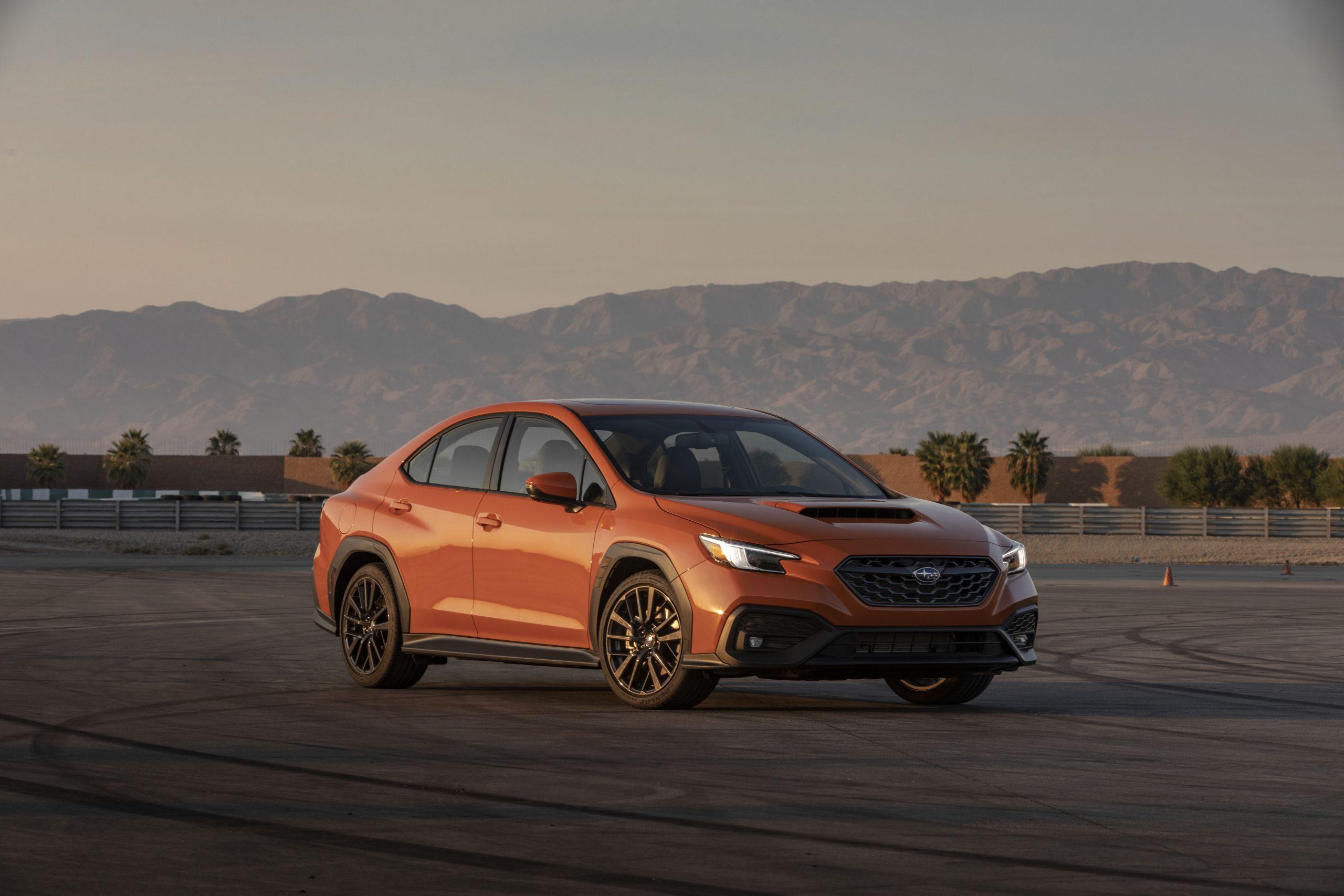 2022 Subaru WRX orange front three-quarter