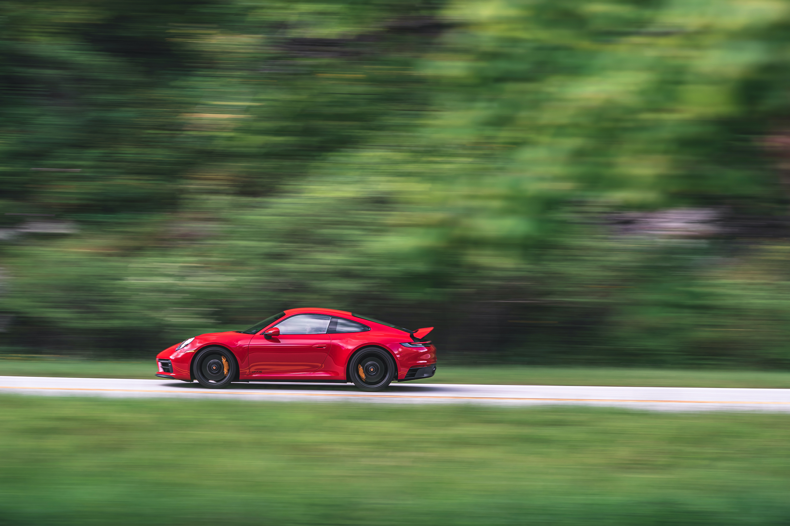 Porsche 911 GTS side profile action
