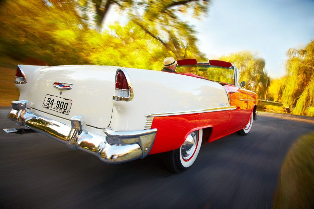 vintage chevy convertible rear three-quarter fall colors
