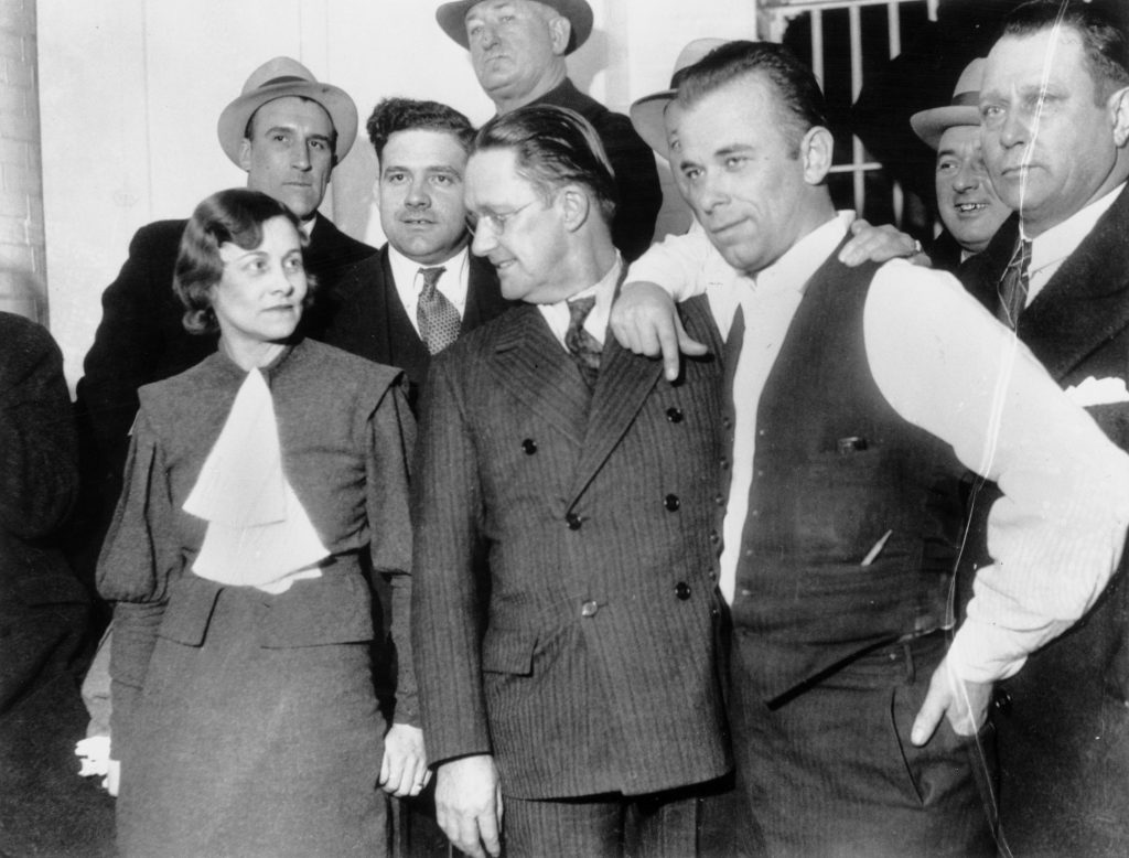 John Dillinger with Police Officials