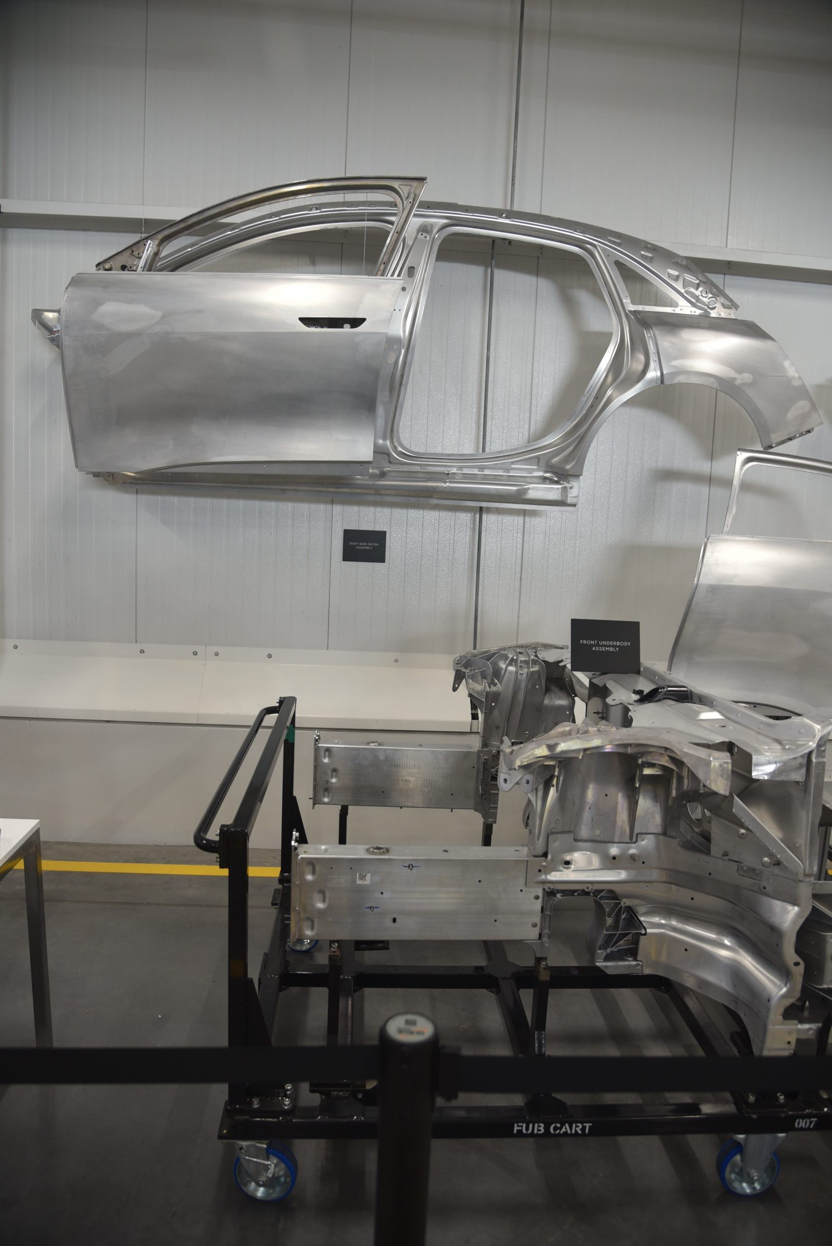 Lucid Air production line body demo vertical