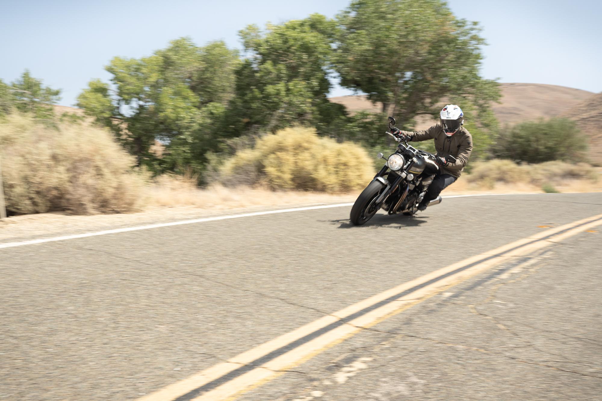 Triumph Speed Twin rider action front three-quarter