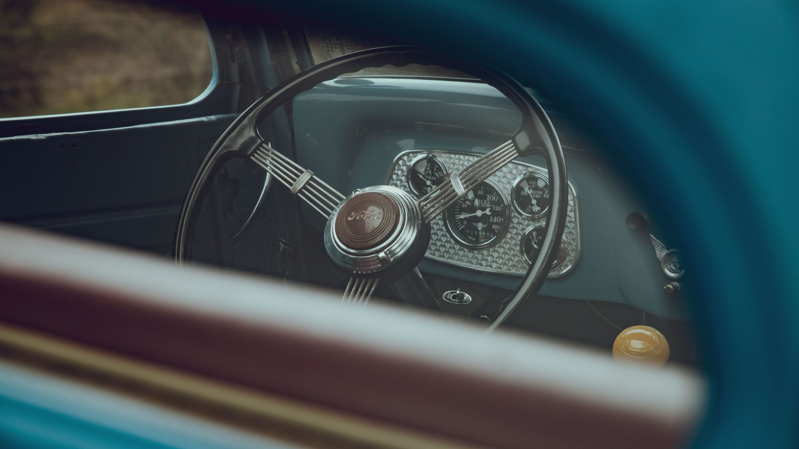 1933 Ford Coupe interior steering wheel through glass