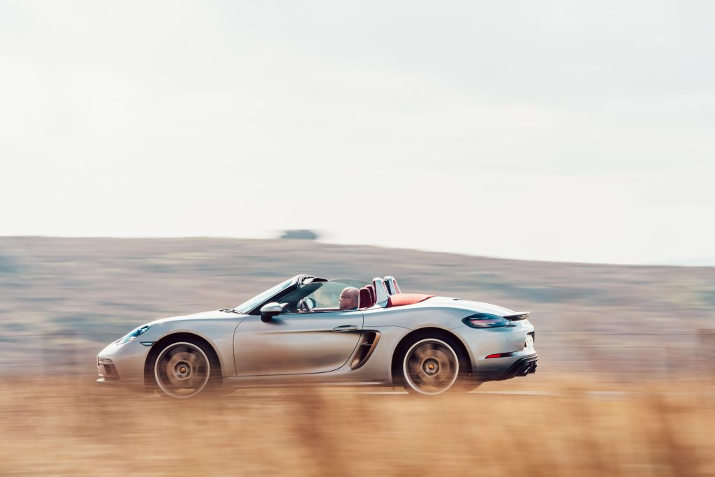 2021 Porsche Boxster 25 Years side profile driving action
