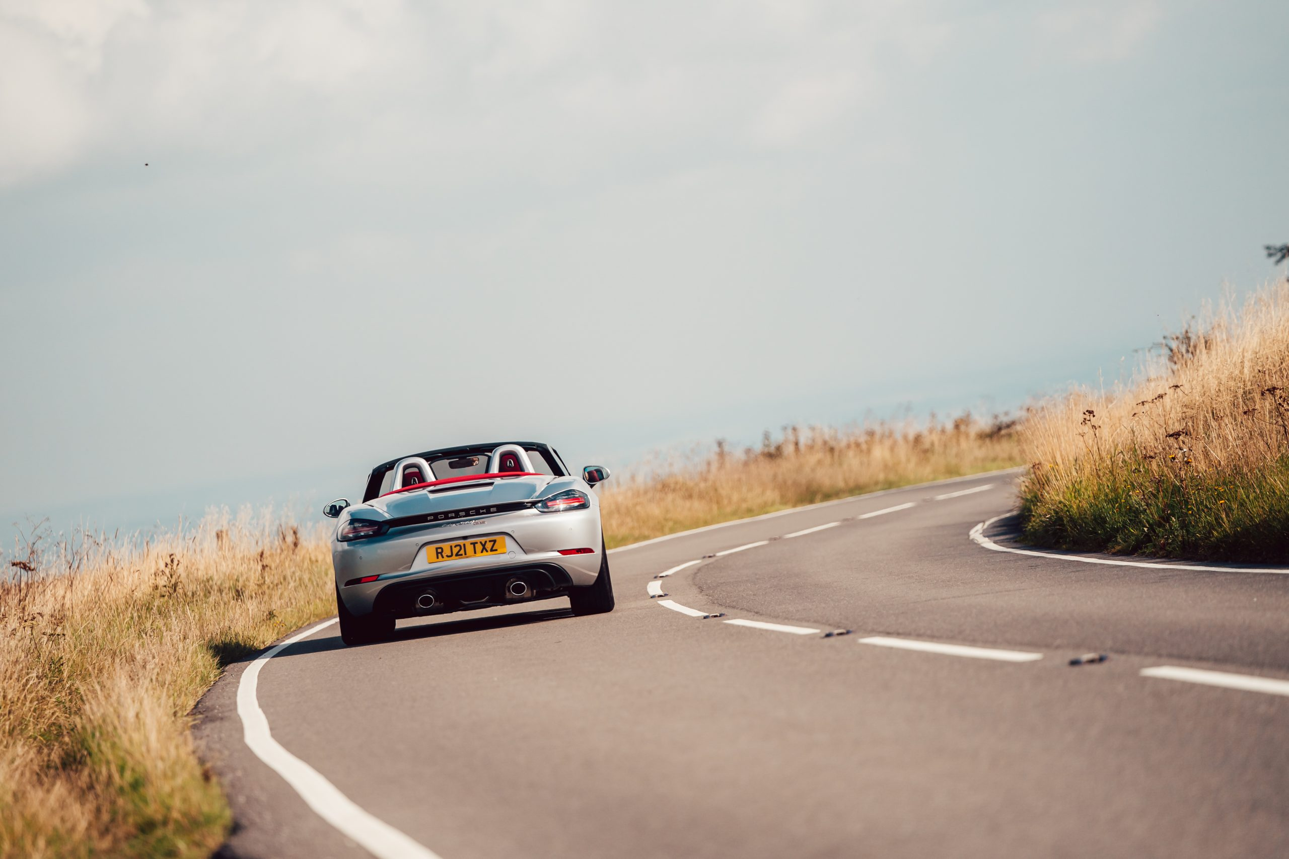 2021 Porsche Boxster 25 Years rear driving action