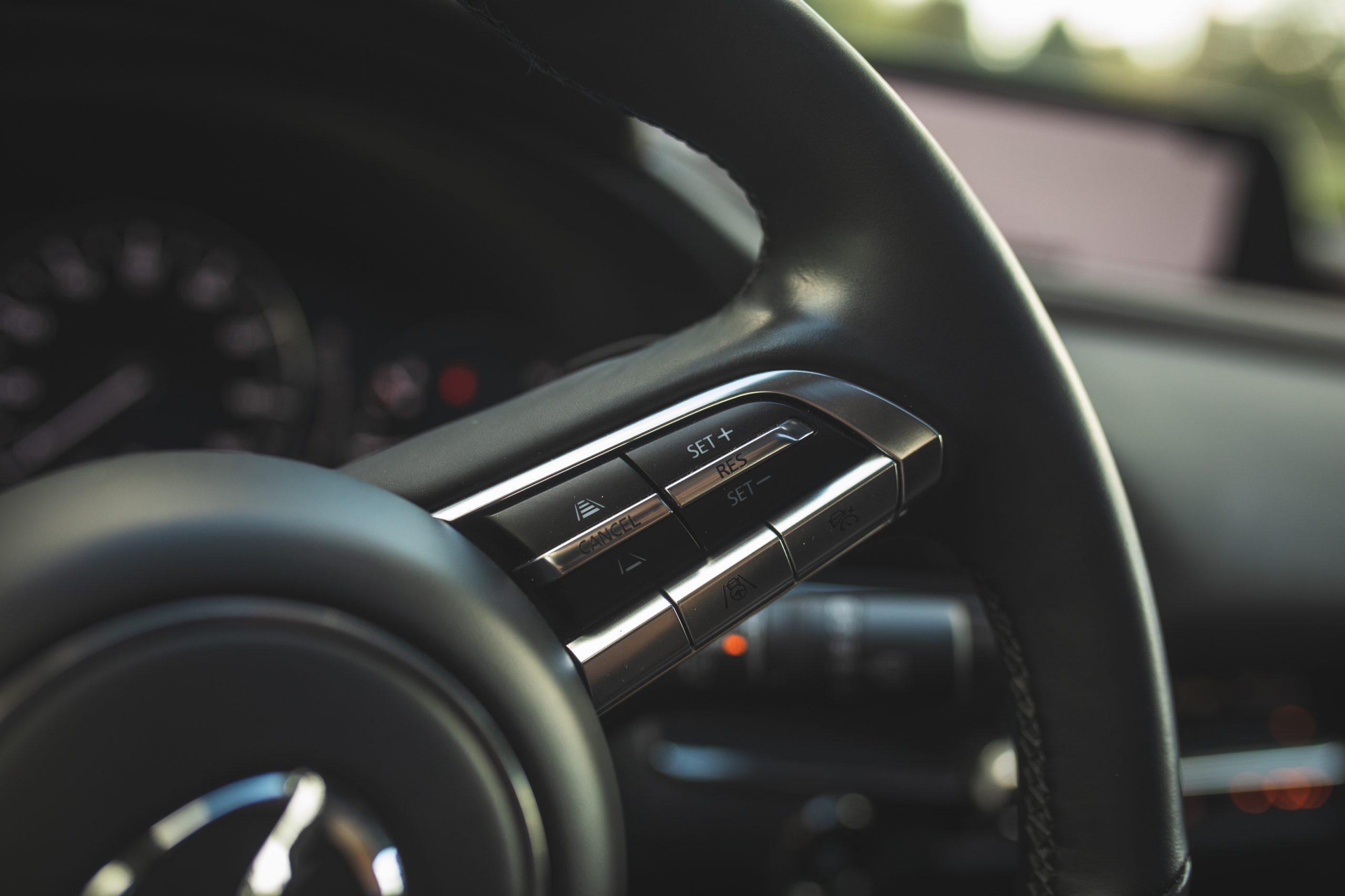 Mazda CX30 interior steering wheel controls