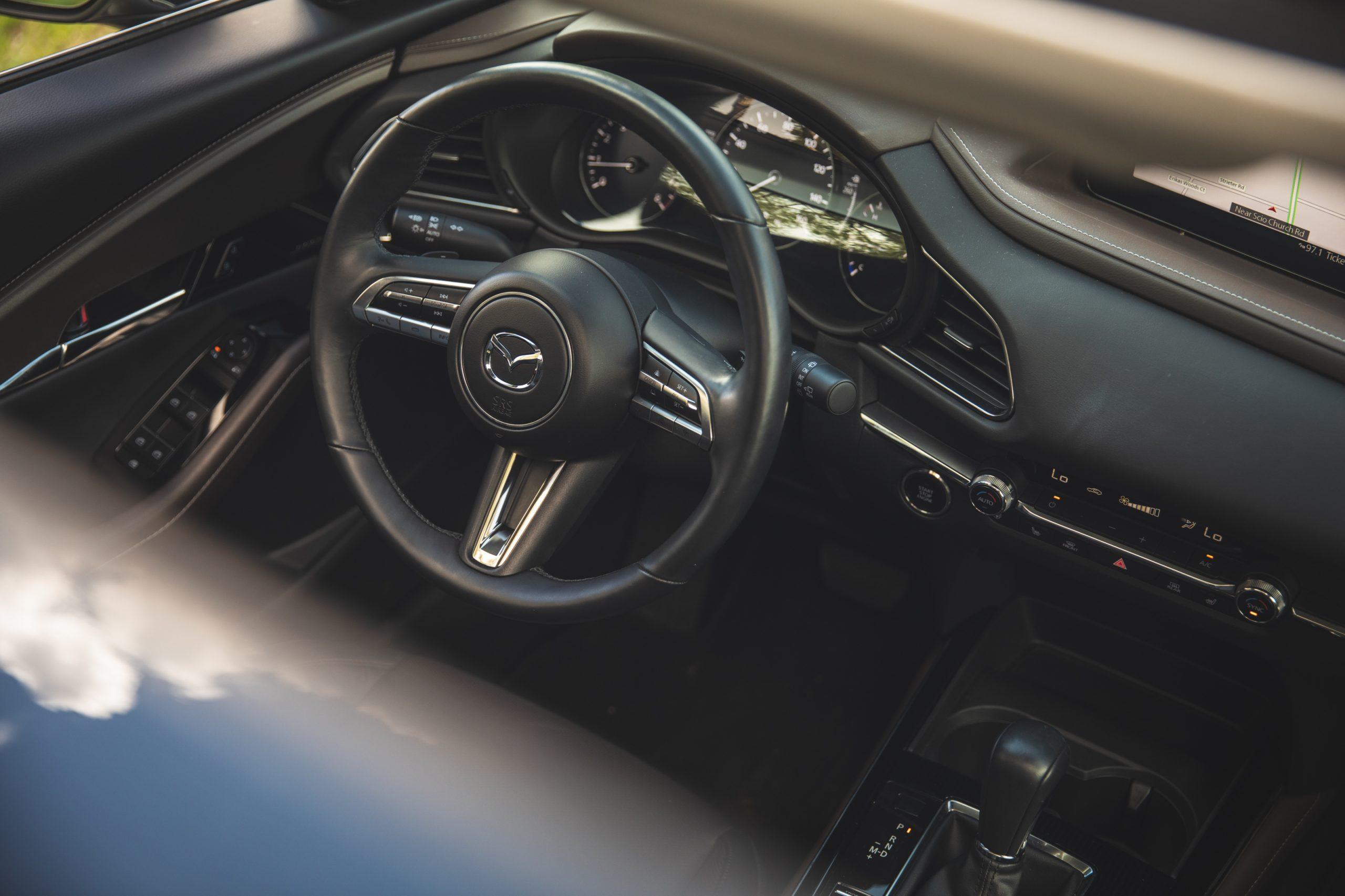 Mazda CX30 interior cockpit through sunroof