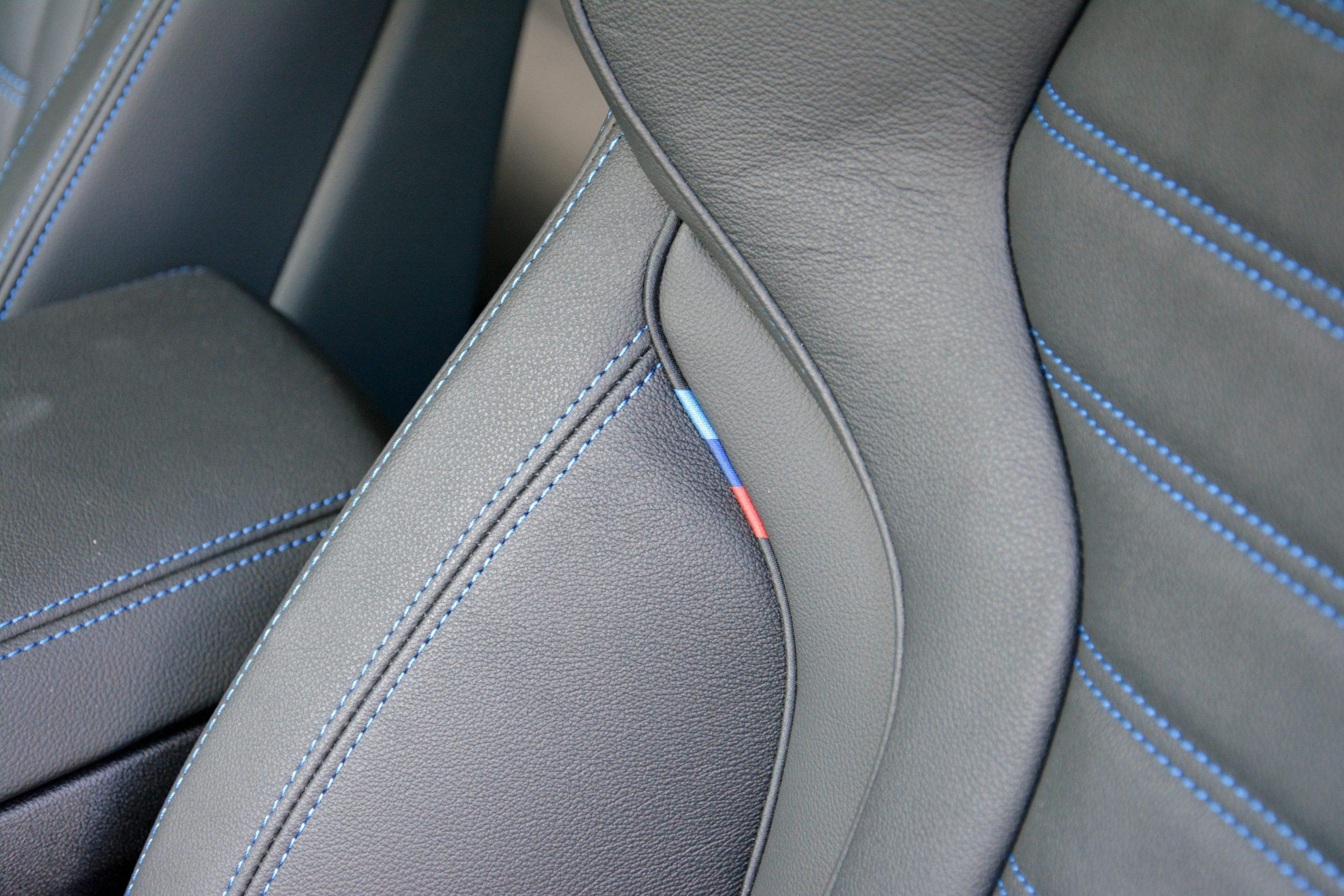 2022 BMW i4 M50 interior leather seat stitching detail