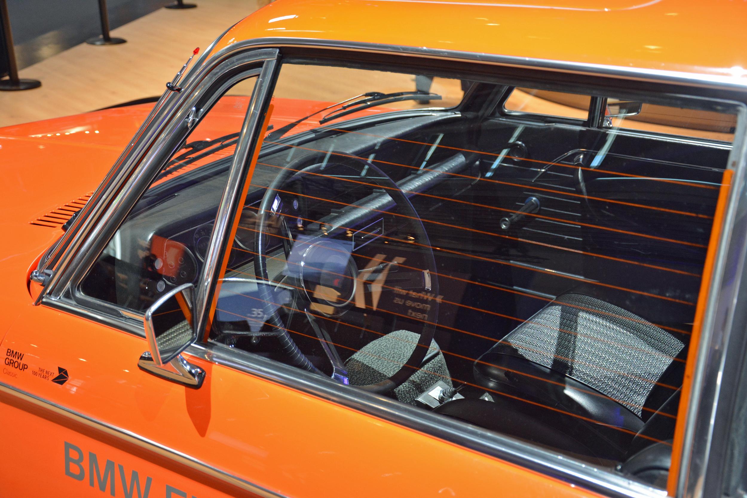 1972 BMW 1602 electric car interior through glass