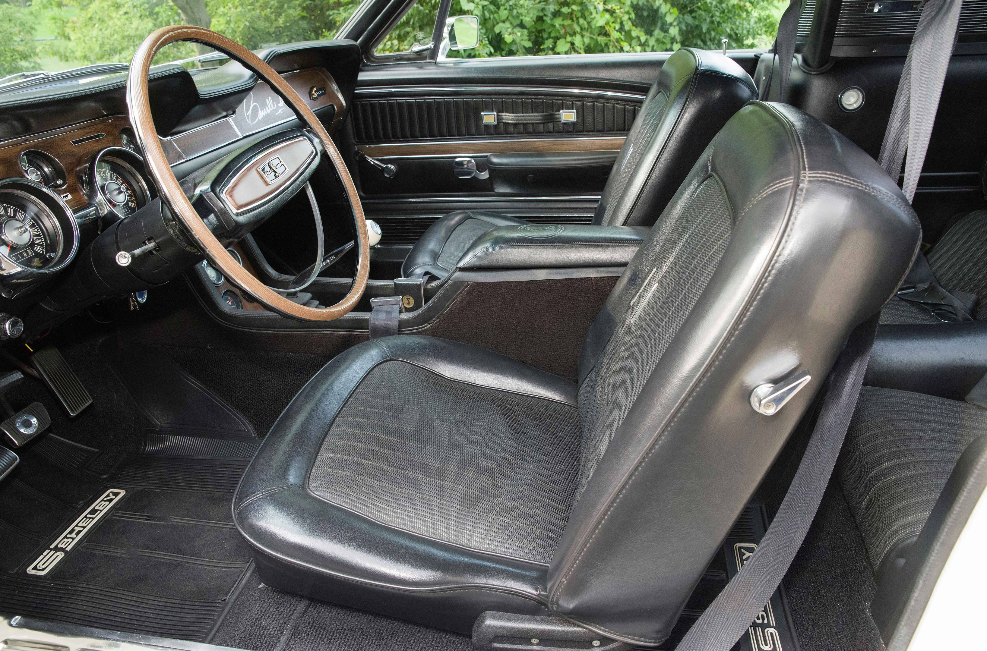 The upholstery and carpeting are in good condition and were probably replaced when the car was restored.