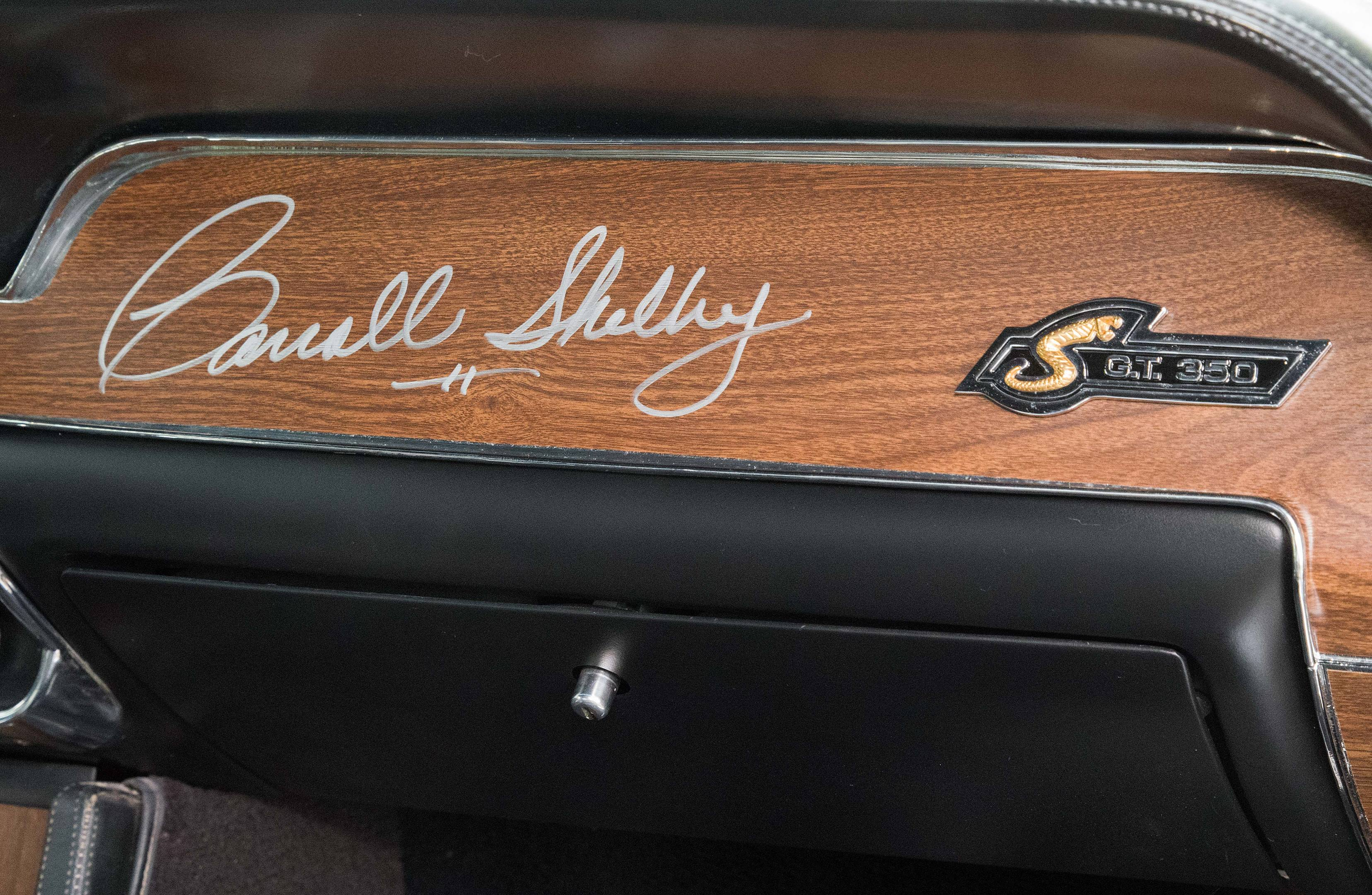 Paul Choukourian purchased the Shelby-autographed instrument panel insert. Shelby raised a lot of money for charity selling panels and dash plaques.