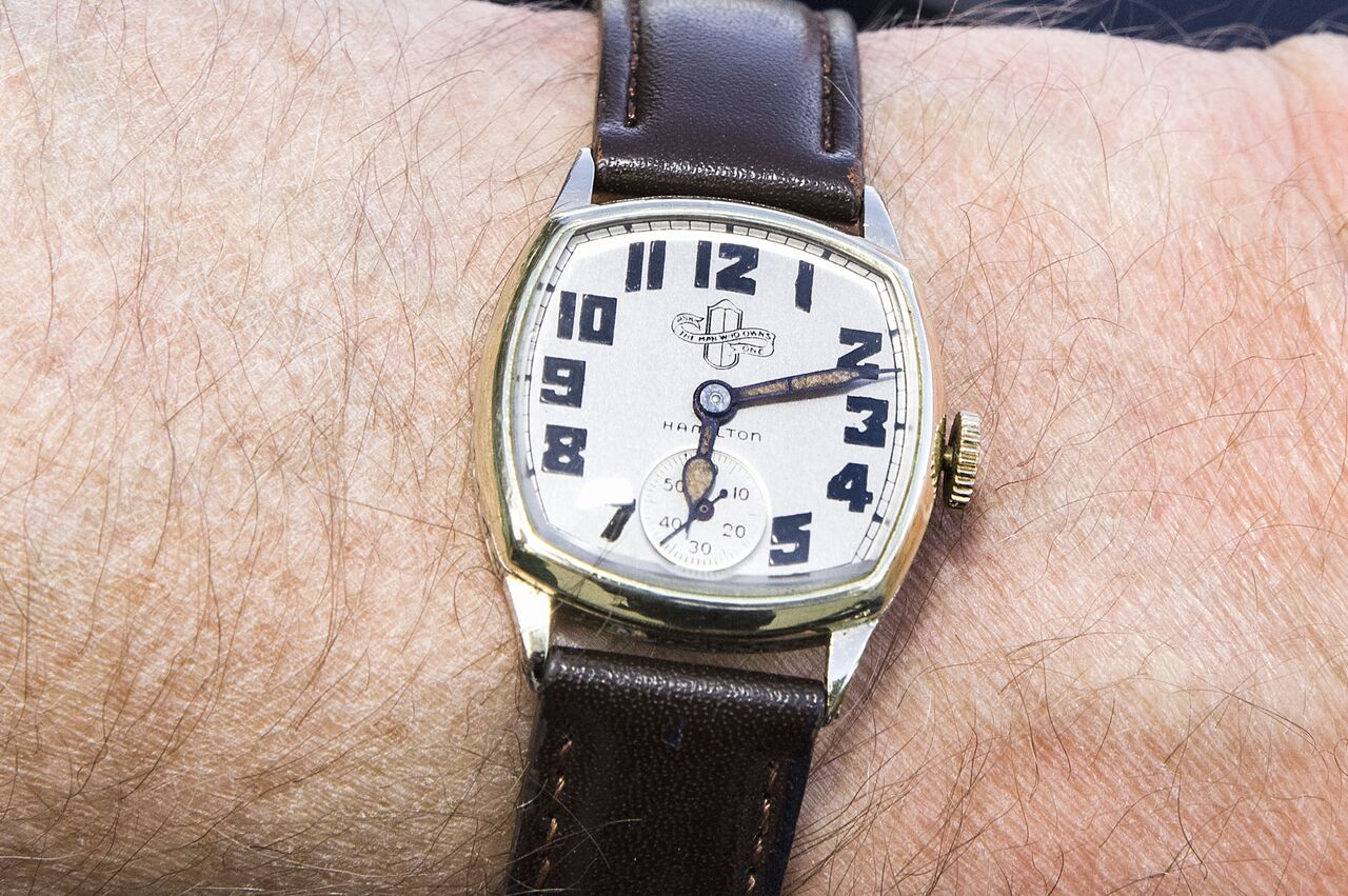 """Ed Krupinski wears a circa 1927 Packard watch. Produced for the automaker by Hamilton, the watch is inscribed with the classic Packard slogan, """"Ask the man who owns one."""""""
