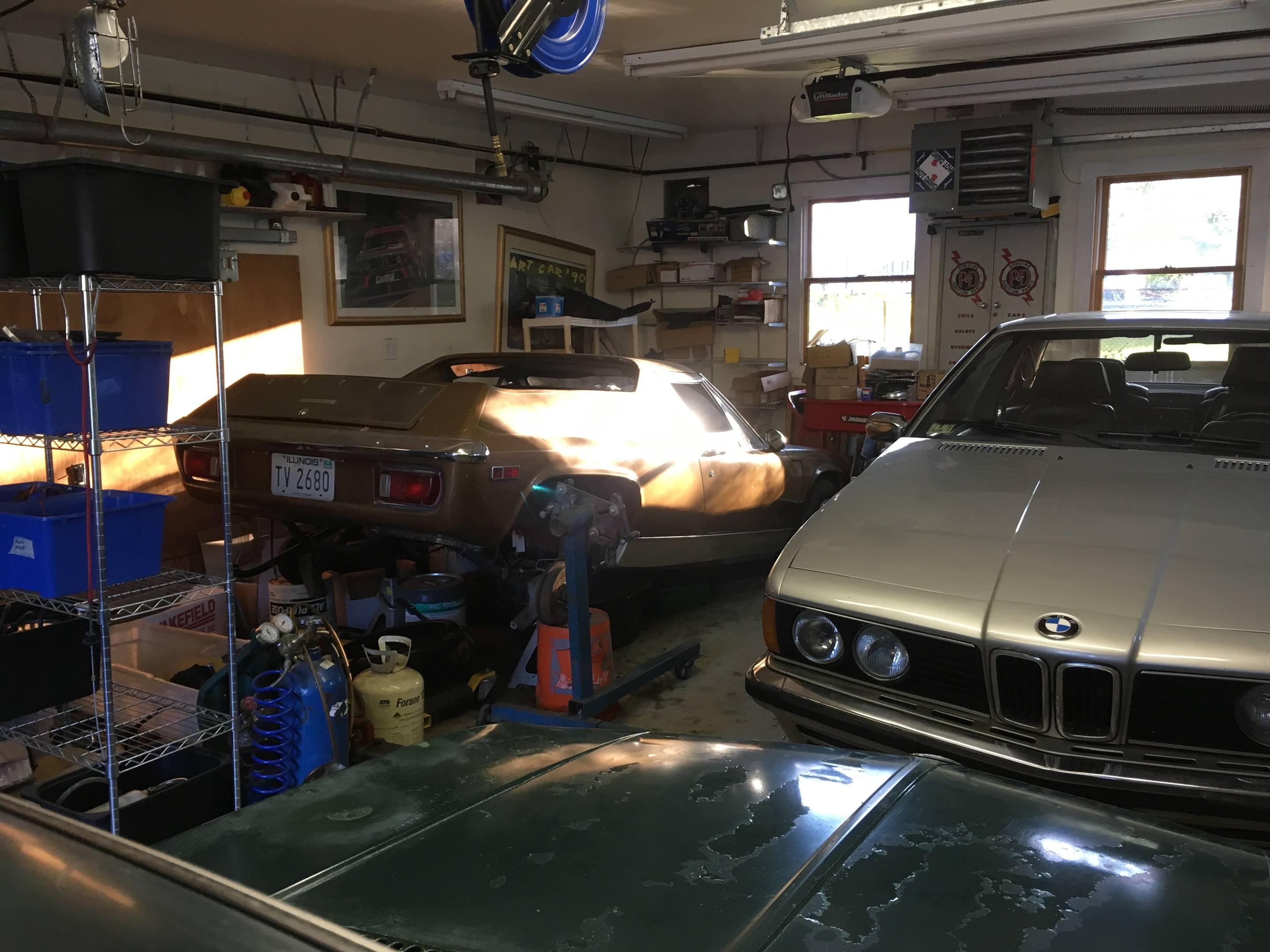 Lotus Europa Twin Cam with BMW in garage