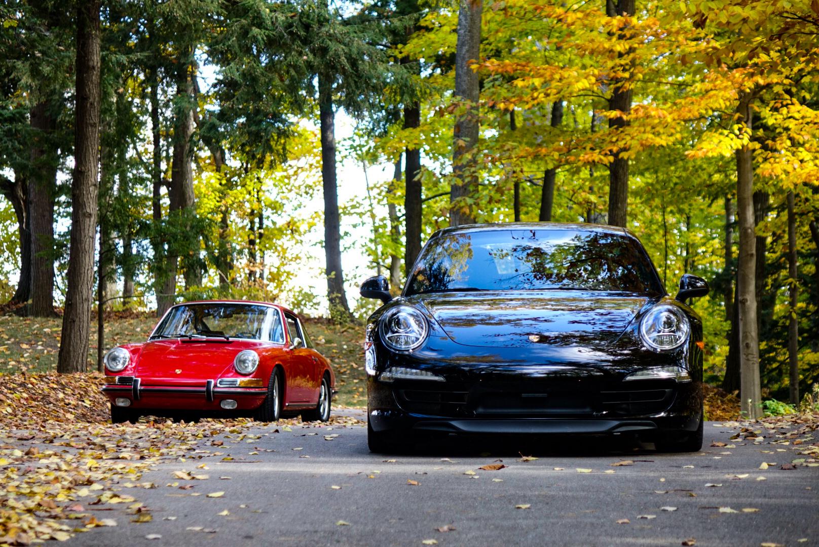 1967 Porsche 911S and 2013 Porsche 911 Carrera 4S front
