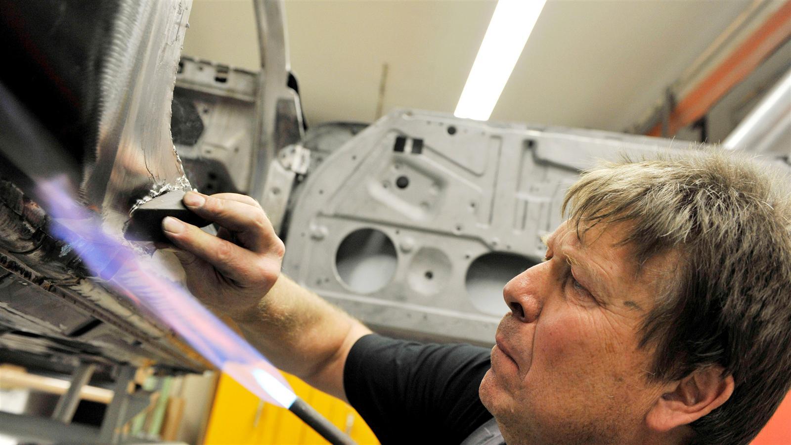 Porsche 911 Factory Restoration metal worker