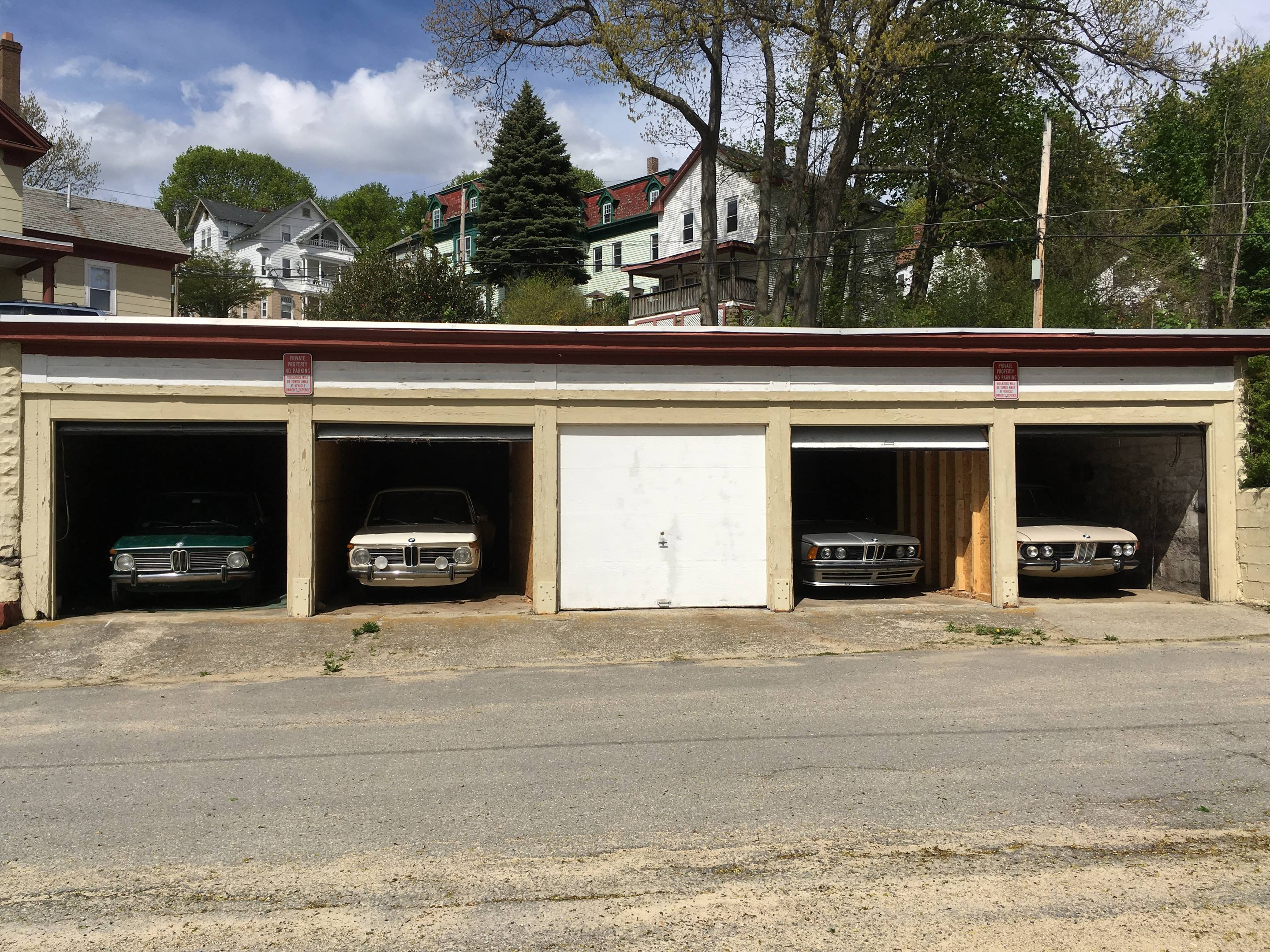 Preparing four cars for winter slumber in one of my storage areas.