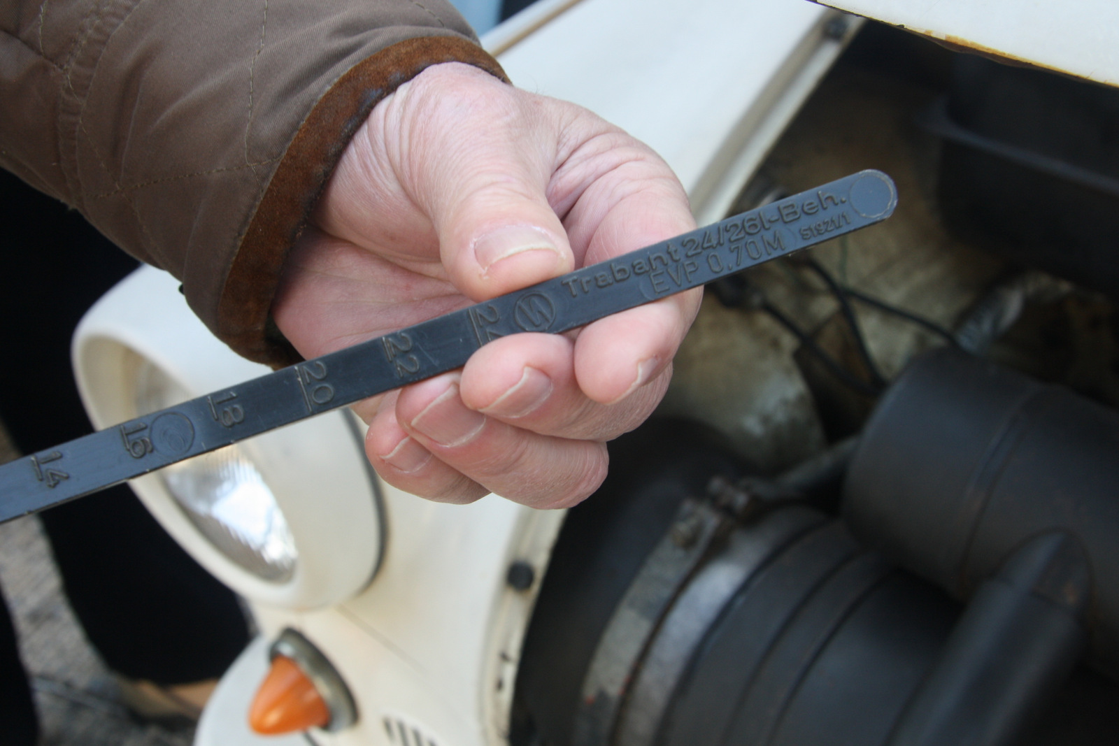 Most Trabants don't have fuel gauges. The motorist must check the fuel by opening the hood and using the supplied dipstick.