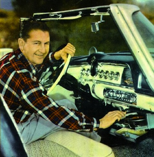 Lawrence Welk shows off a Highway Hi-Fi system in his 1956 Chrysler convertible.