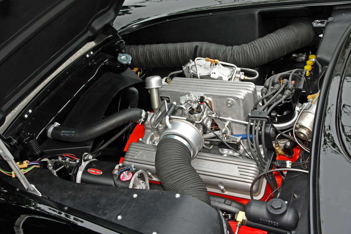 """The fiberglass plenum, nicknamed the """"airbox,"""" was installed on the driver's side. The longer tube on the passenger side routed air to the rear brakes via ducting in the rocker channel"""