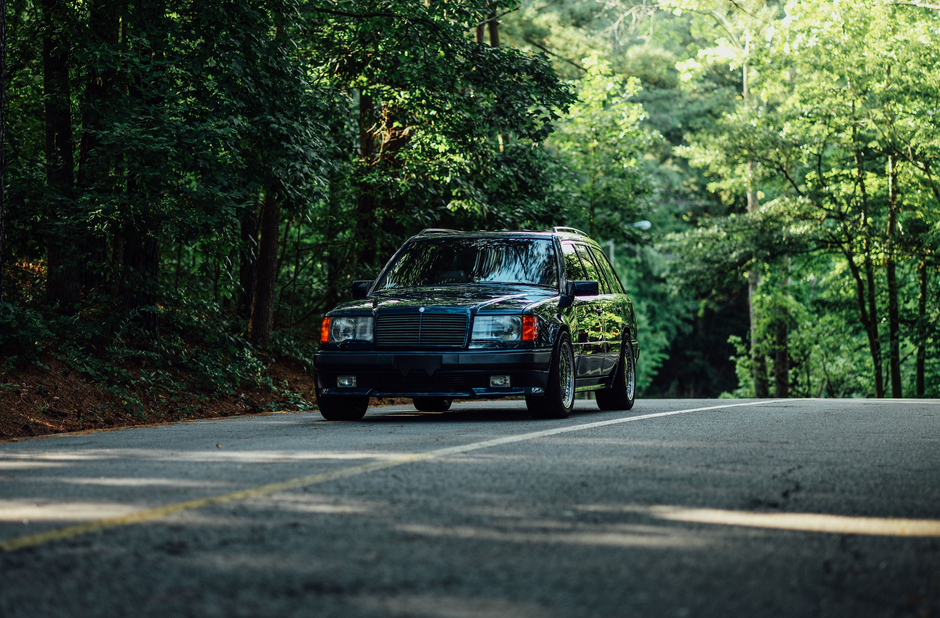 mercedes benz 500e hammer wagon amg front woods road