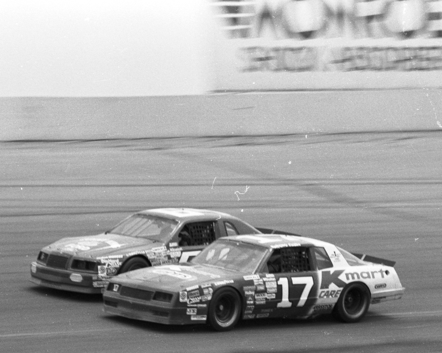 Pancho Carter drives the No. 17 K-Mart/Wynn's Oil Chevrolet for Hamby Racing inside Eddie Bierschwale's No.64 Sunny King Ford-Honda Ford in the NASCAR Winston Cup Series Miller High Life 500 at Pocono Raceway, June 8, 1986