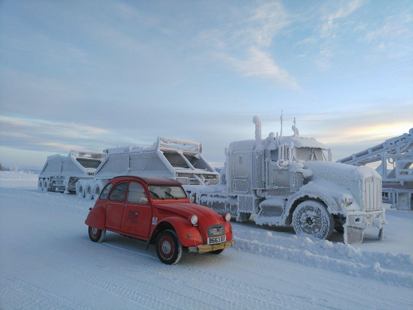 Citroën 2CV next to a frozen semi truck