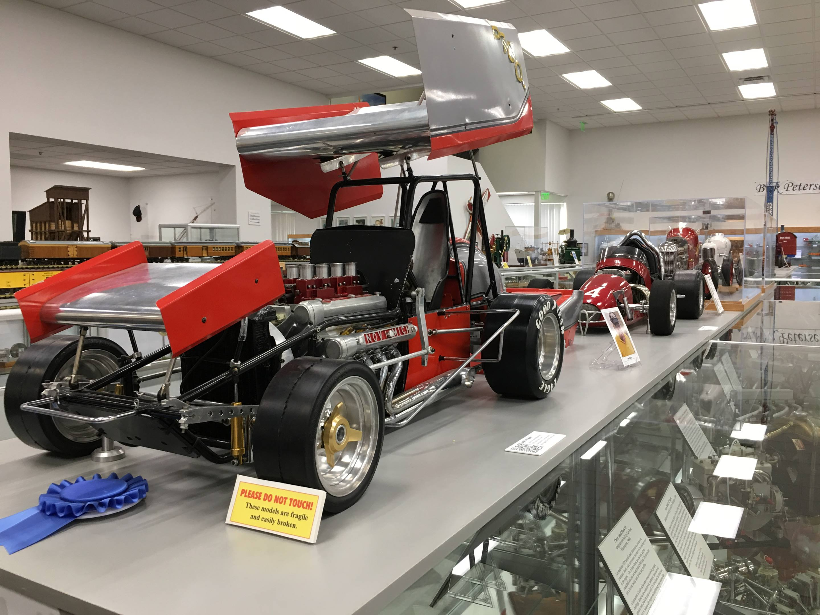 This quarter-scale Novi sprint car was built by Jim Riggle of North Dakota in the mid 1980s and features a working dual-overhead-cam four-cylinder with a one-inch bore and stroke.