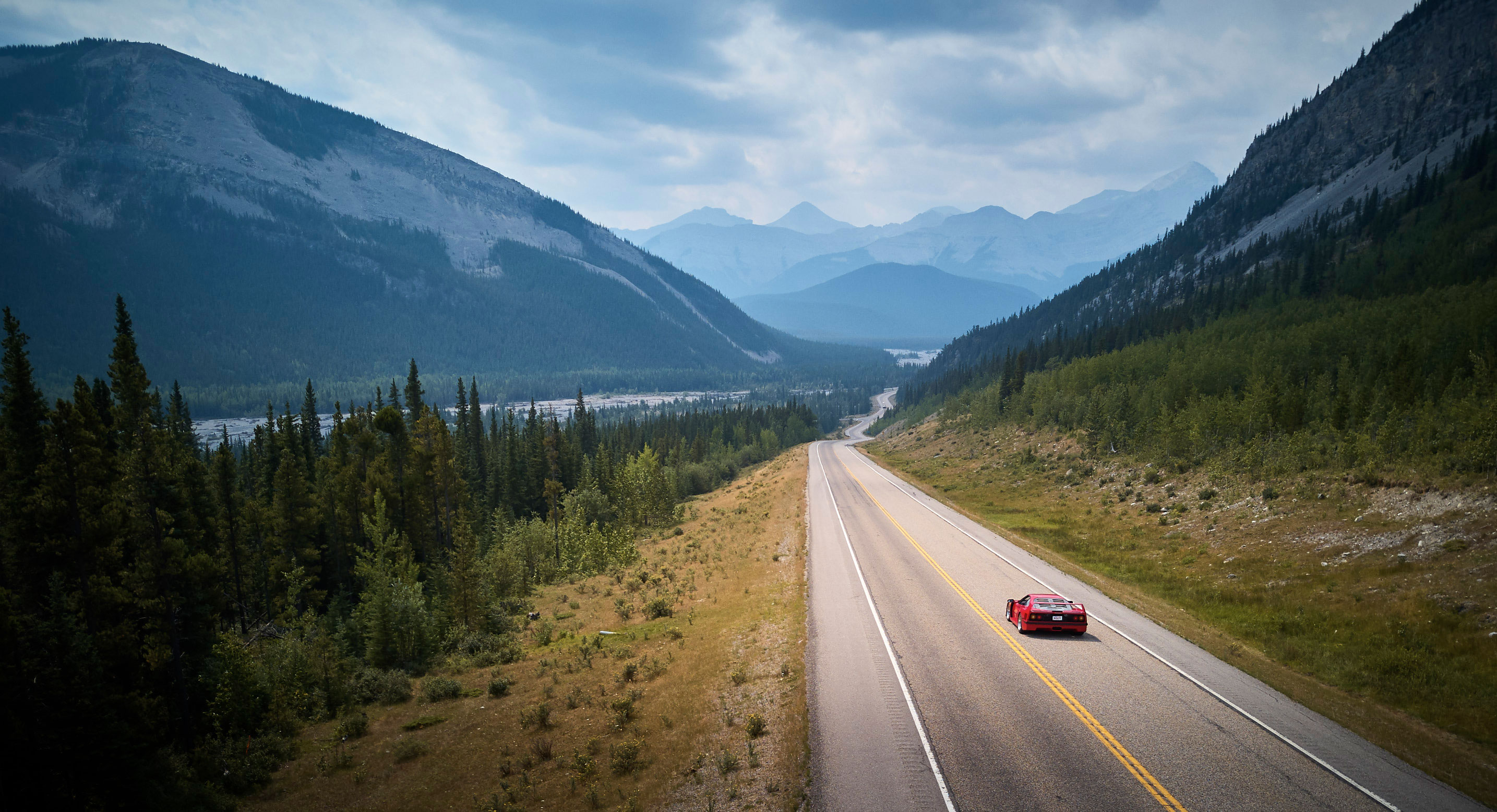 Highway 66 is foot-to-the-floor glorious as it parallels the Elbow River in Kananaskis Country, west of Calgary.