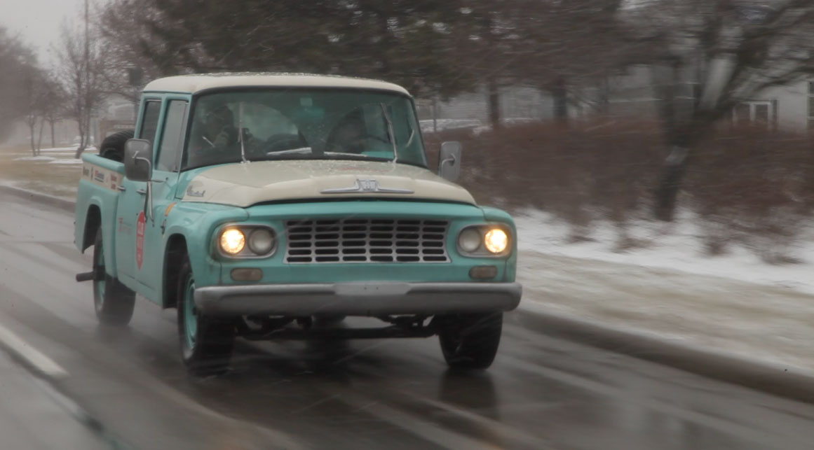 1962 International Travelette pick up front view in the snow
