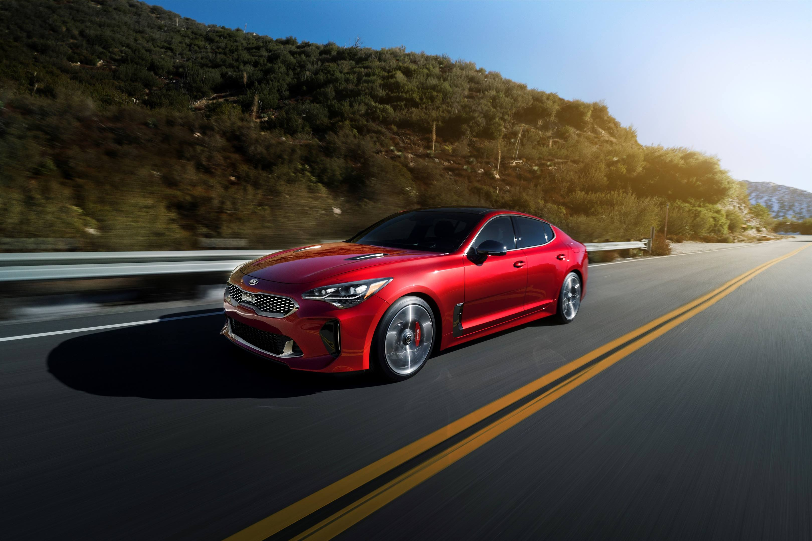 2018 Kia Stinger GT driving down the highway