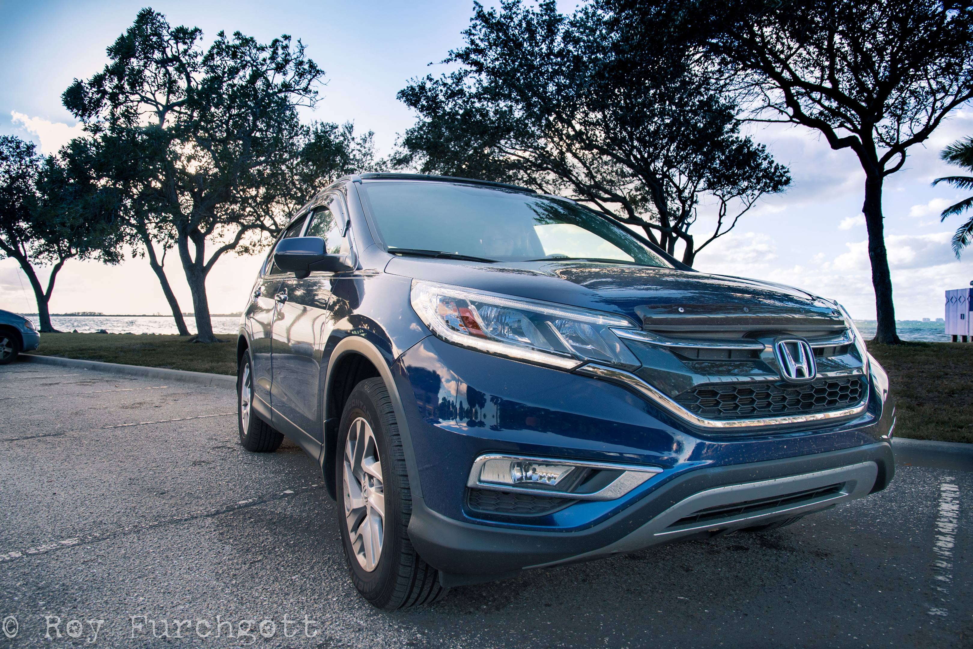 A wide-angle lens makes even a dirty Honda CRV look aggressive, which is useful for those beauty shots—but not for sales. And watch for distracting reflections in the paint.