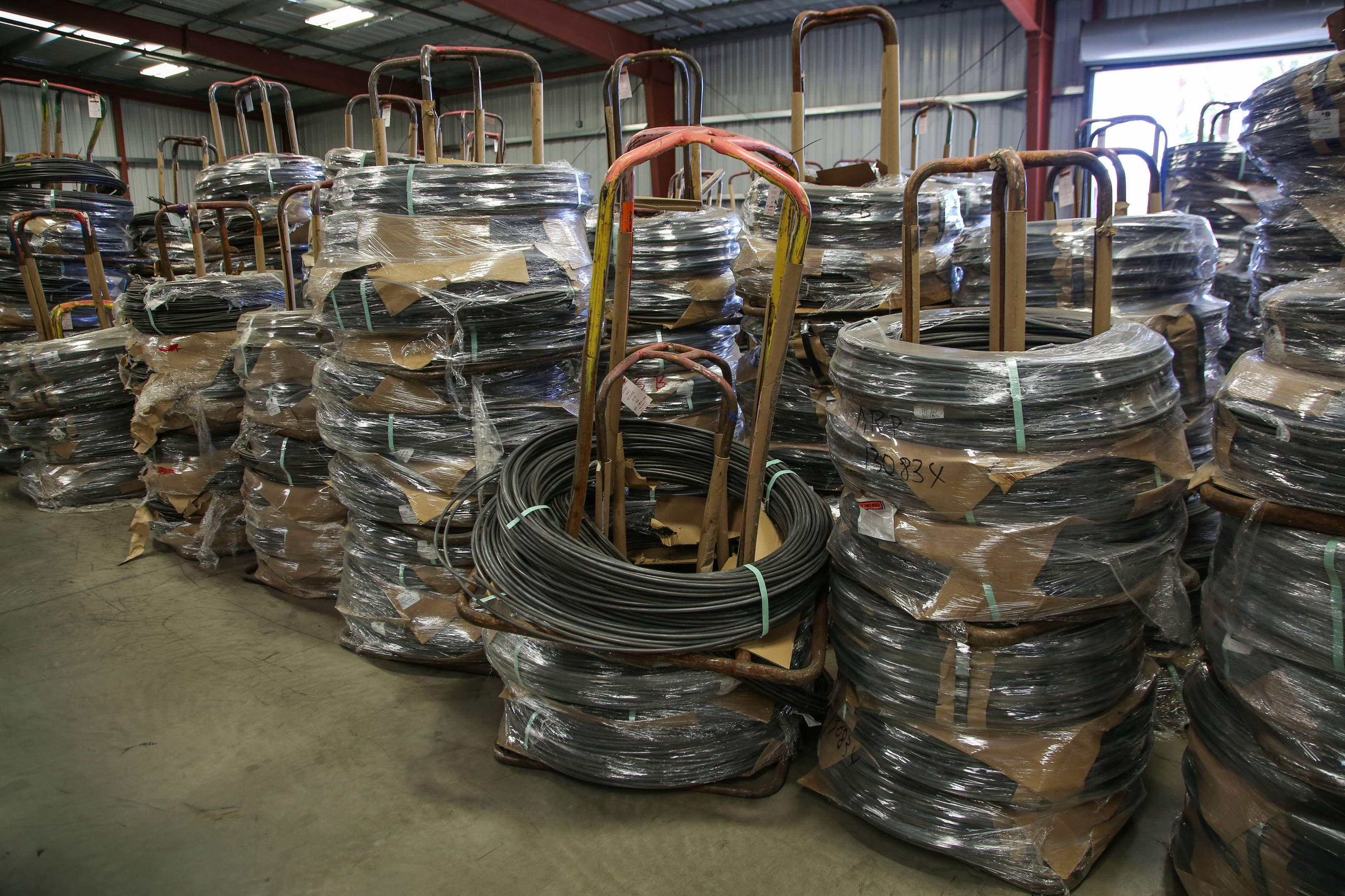 Spools of wire arrive by the truckload and are loaded in warehouses