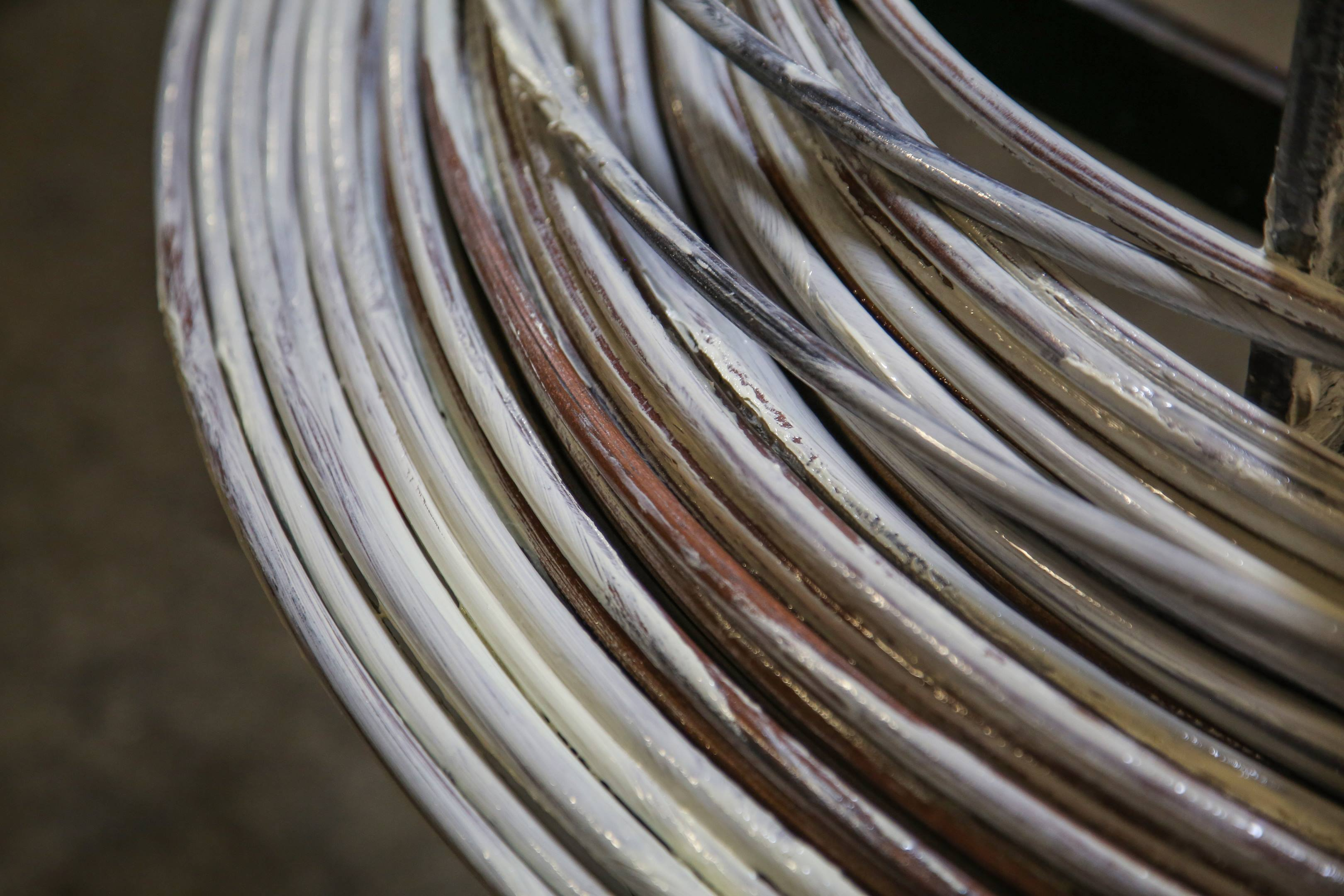 Wire is coated with lubricant prior to forging.