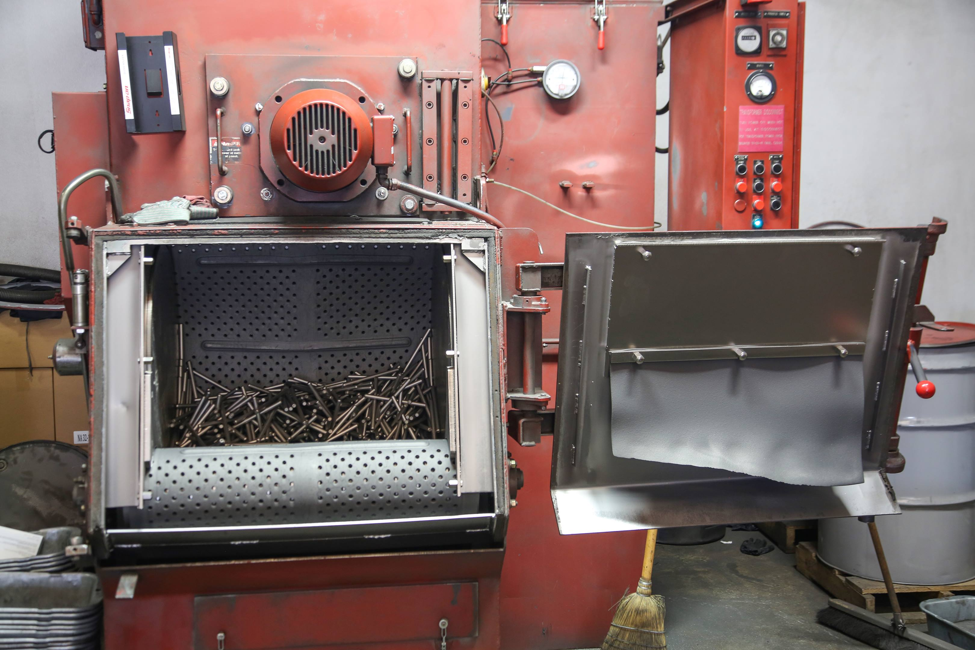 Shot peening cleans the parts and removes scale without removing material.