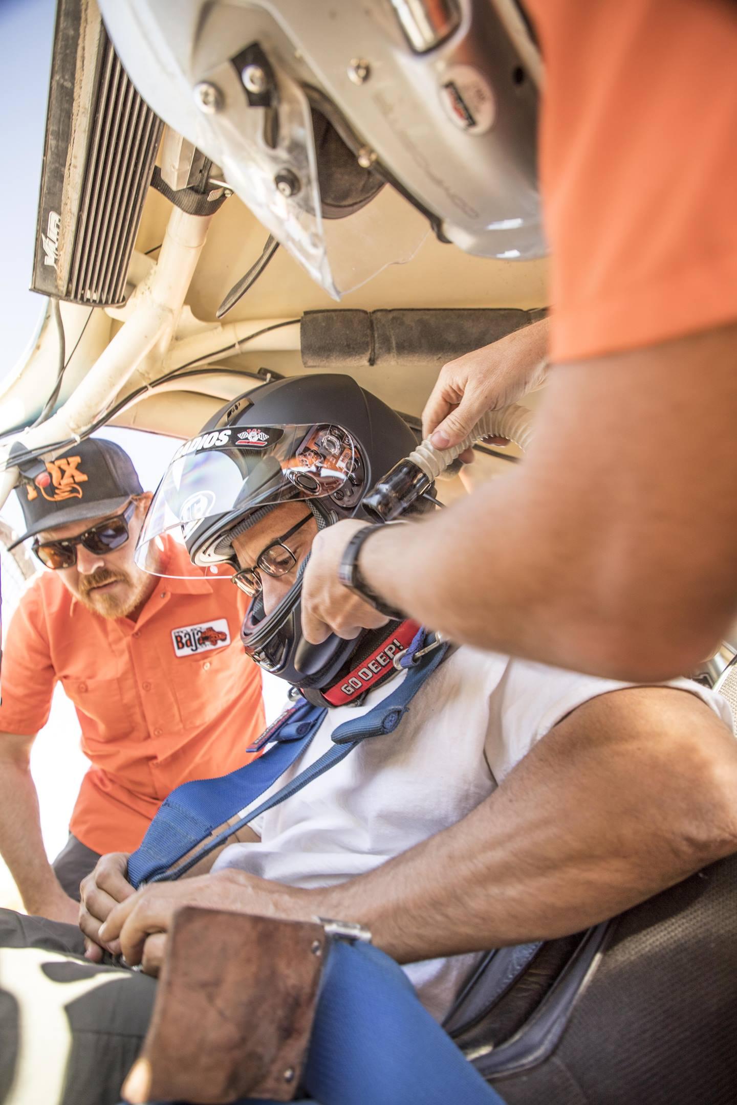 Aaron Robinson getting ready to drive a BAJA VW Bug