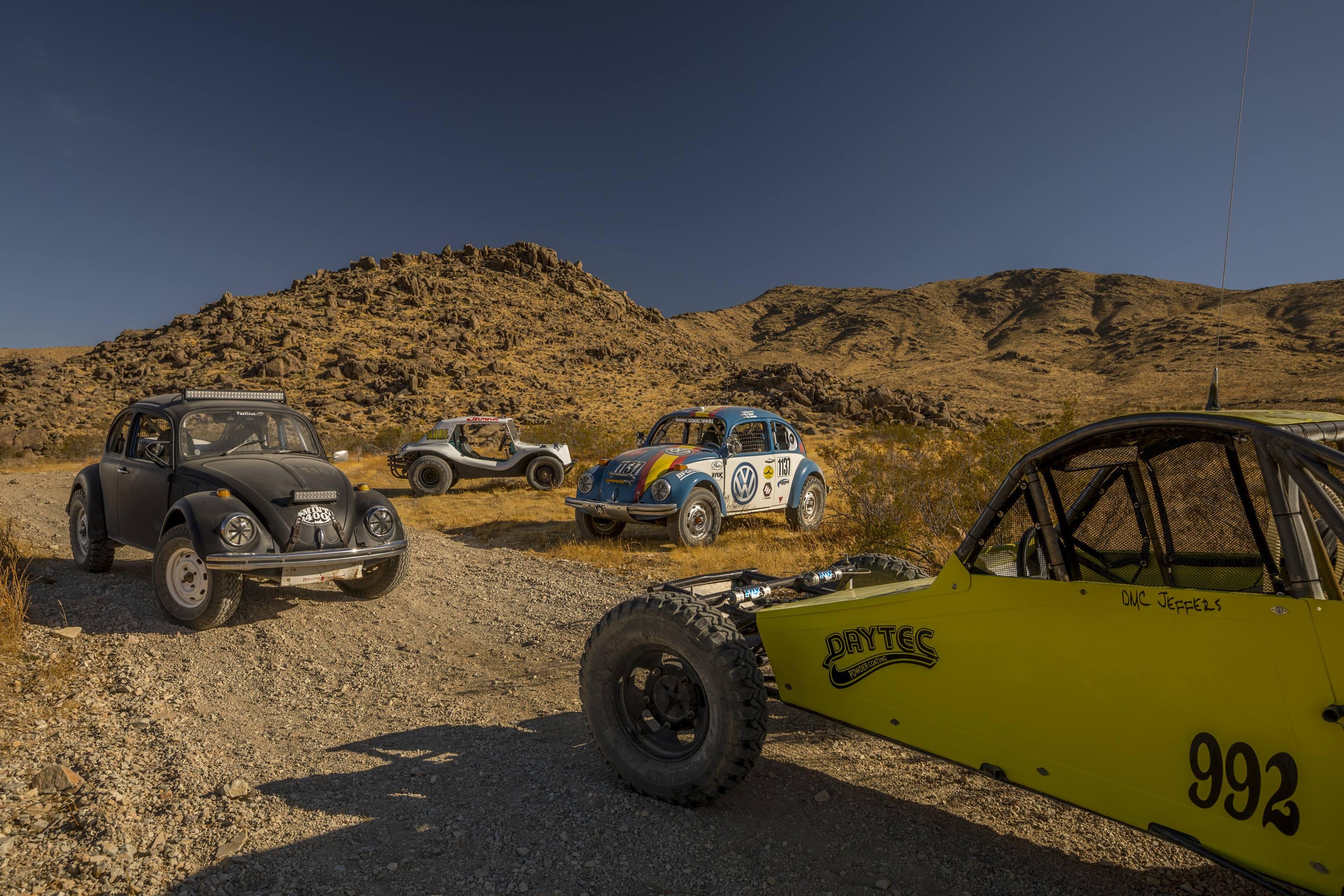 group of Volkswagens in the desert