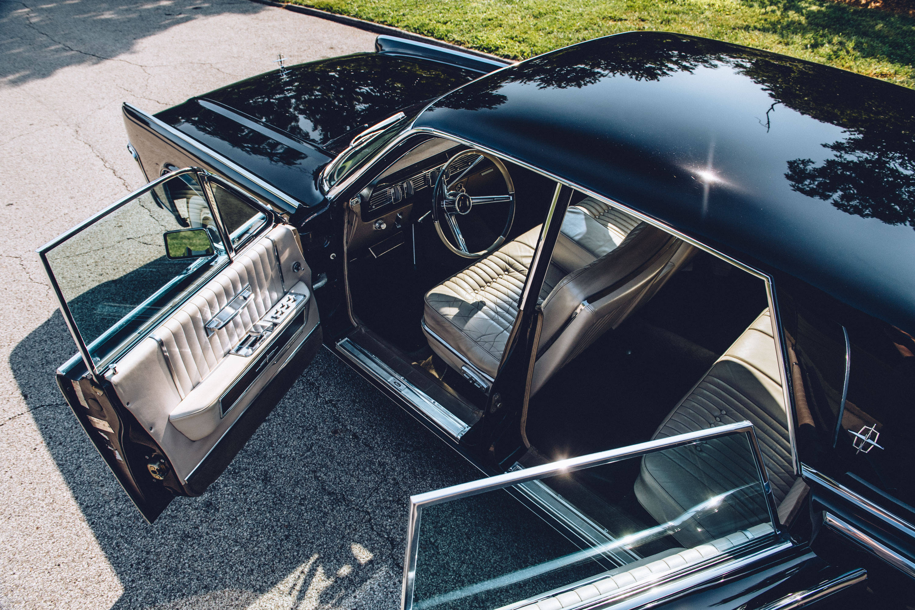 """Optional air conditioning cost $504 in '64, one-quarter the price of an entire base Falcon, on a car that started at $6292 for the hardtop. Rear-hinged """"suicide"""" doors and B-pillars the thickness of soda straws are signs of the times."""