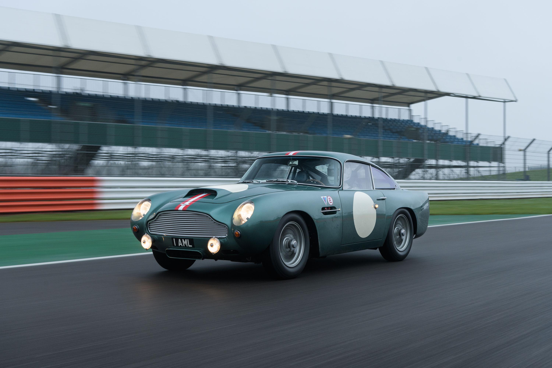 Green 1959 Aston Martin DB4 GT profile on the track