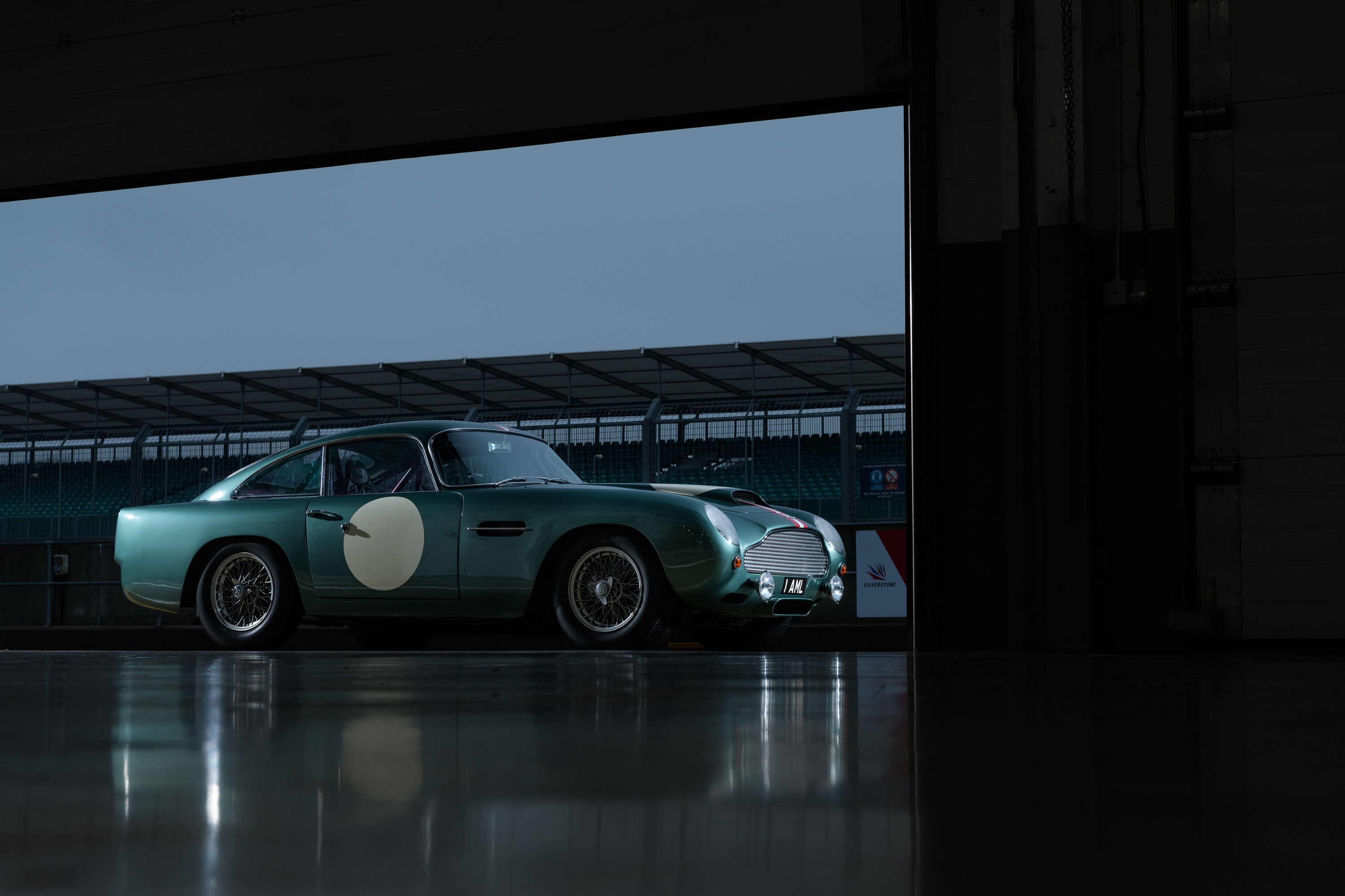 Aston Martin DB4 GT in the paddock after sunset