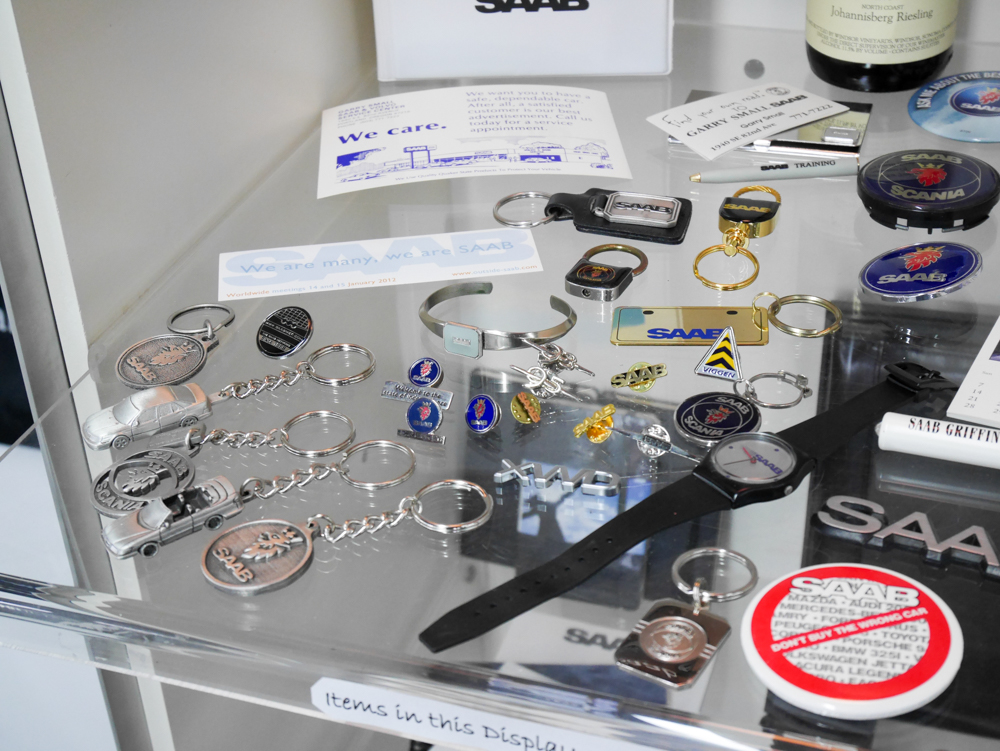 Trinkets and swag from the new-car years. The showroom is as much a museum now.
