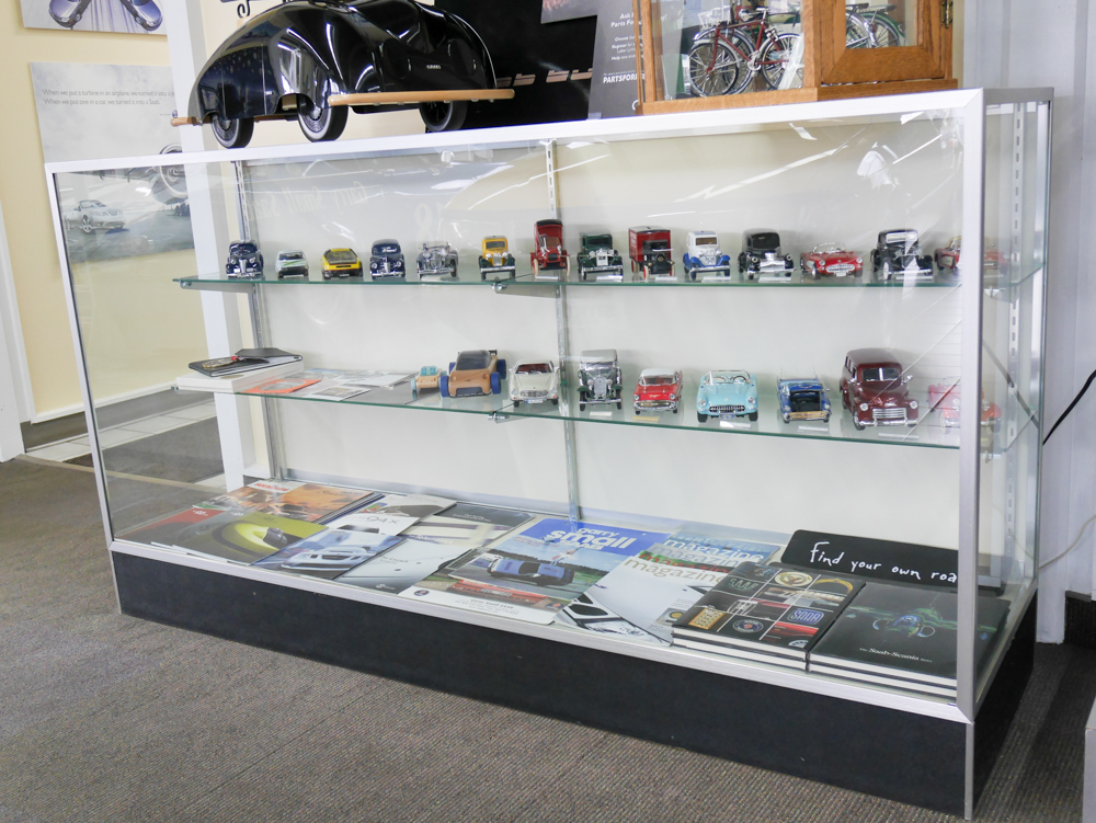 Old brochures and model cars. Car folks will be happy here.