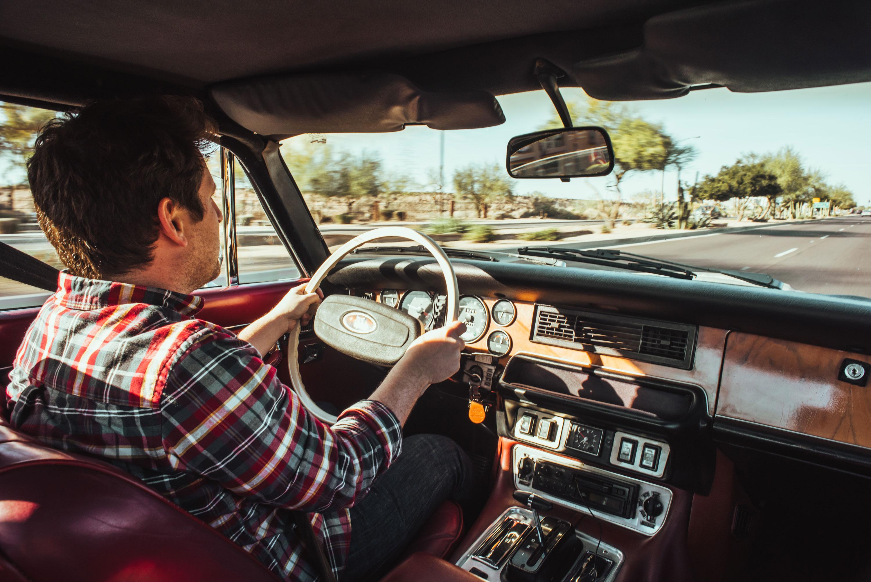 Eric Weiner behind the wheel of a 1974 Jaguar XJ6