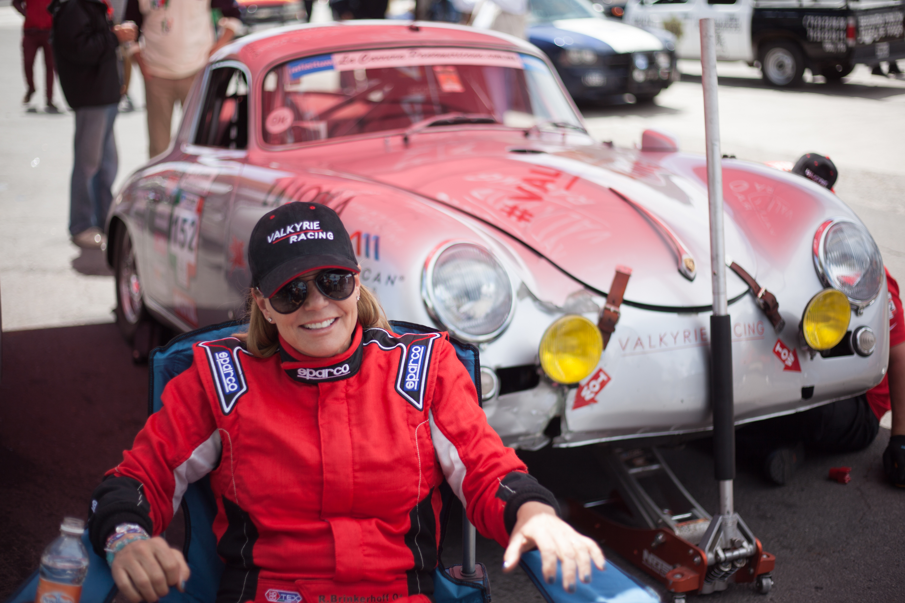 Brinkerhoff waits while her damaged Porsche is prepped for next race stage in the La Carrera Panamericana 2015.