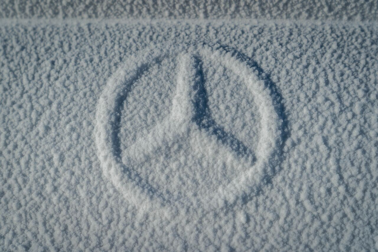 Snow covered Mercedes-Benz