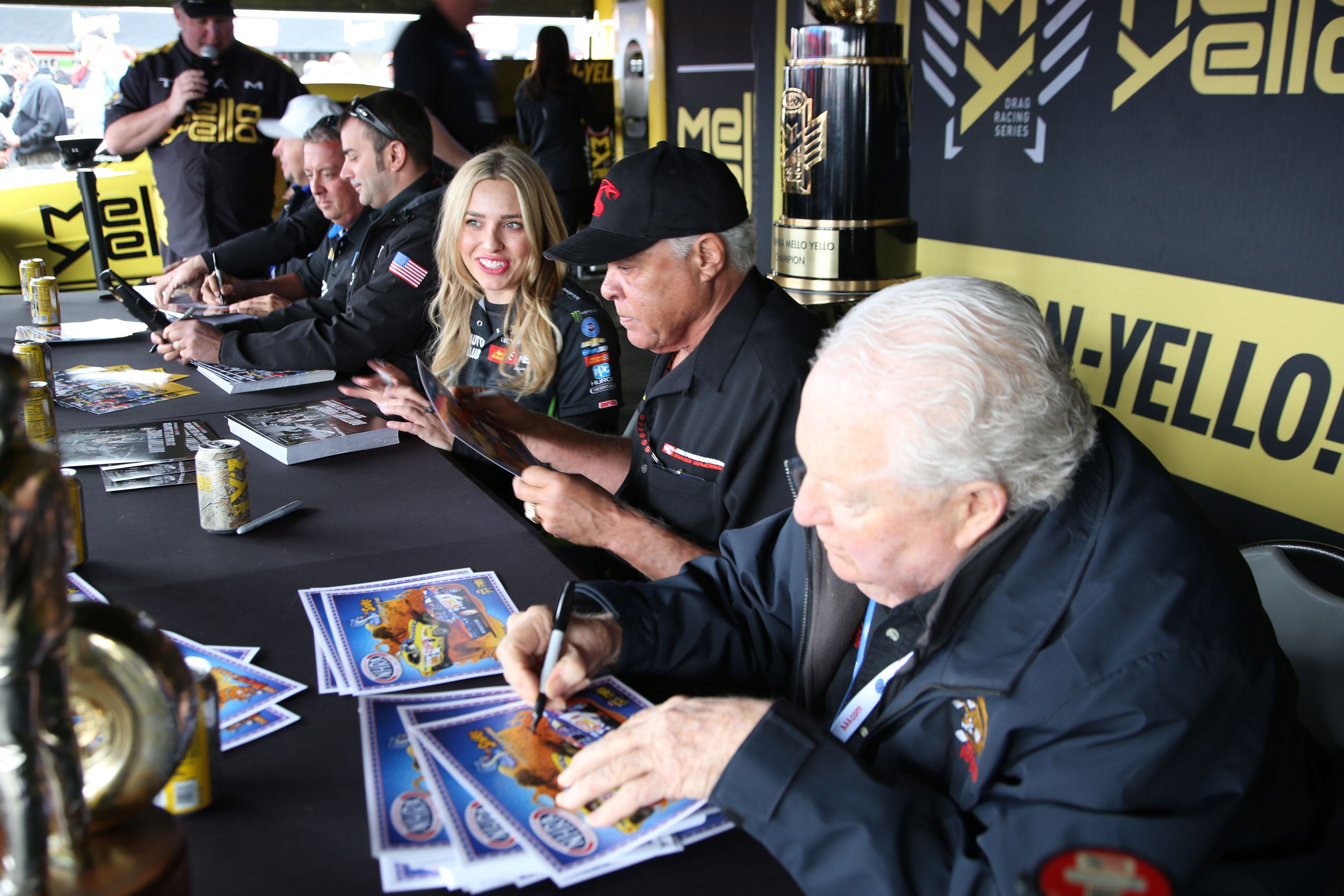 """From back to front: 2017 Funny Car Champ, Robert Hight, 2017 Pro Stock Champ Bo Butner, 2017 Pro Stock Motorcycle Champ Eddie Krawiec, 2017 Top Fuel Dragster Champ Brittany Force, Don """"the Snake"""" Prudhomme, and Tom """"the Mongoose"""" McEwen."""
