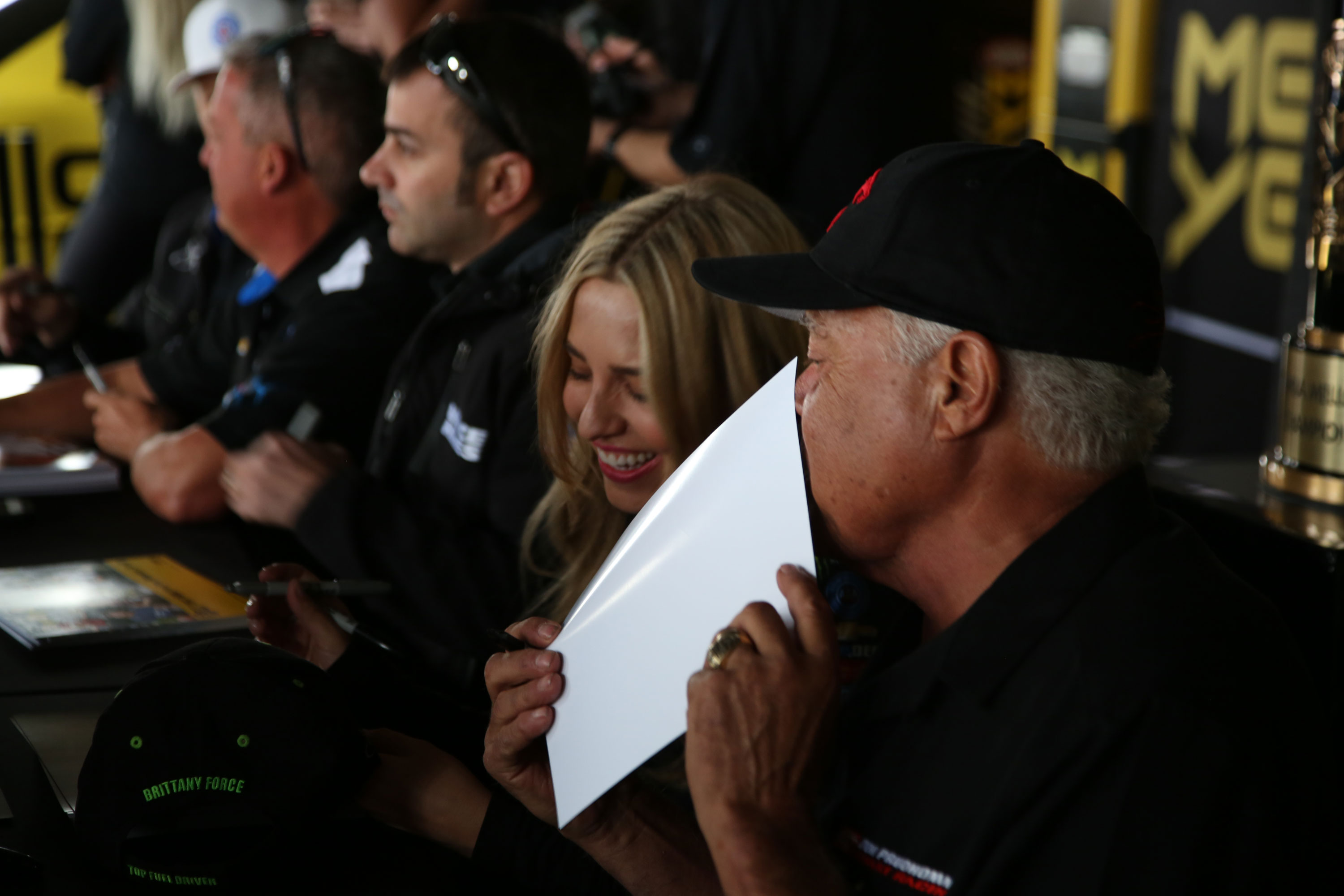 """The Snake making dragster driver Brittany Force laugh. """"What did he say that made you laugh?"""" we asked, and she answered, """"Everything."""""""