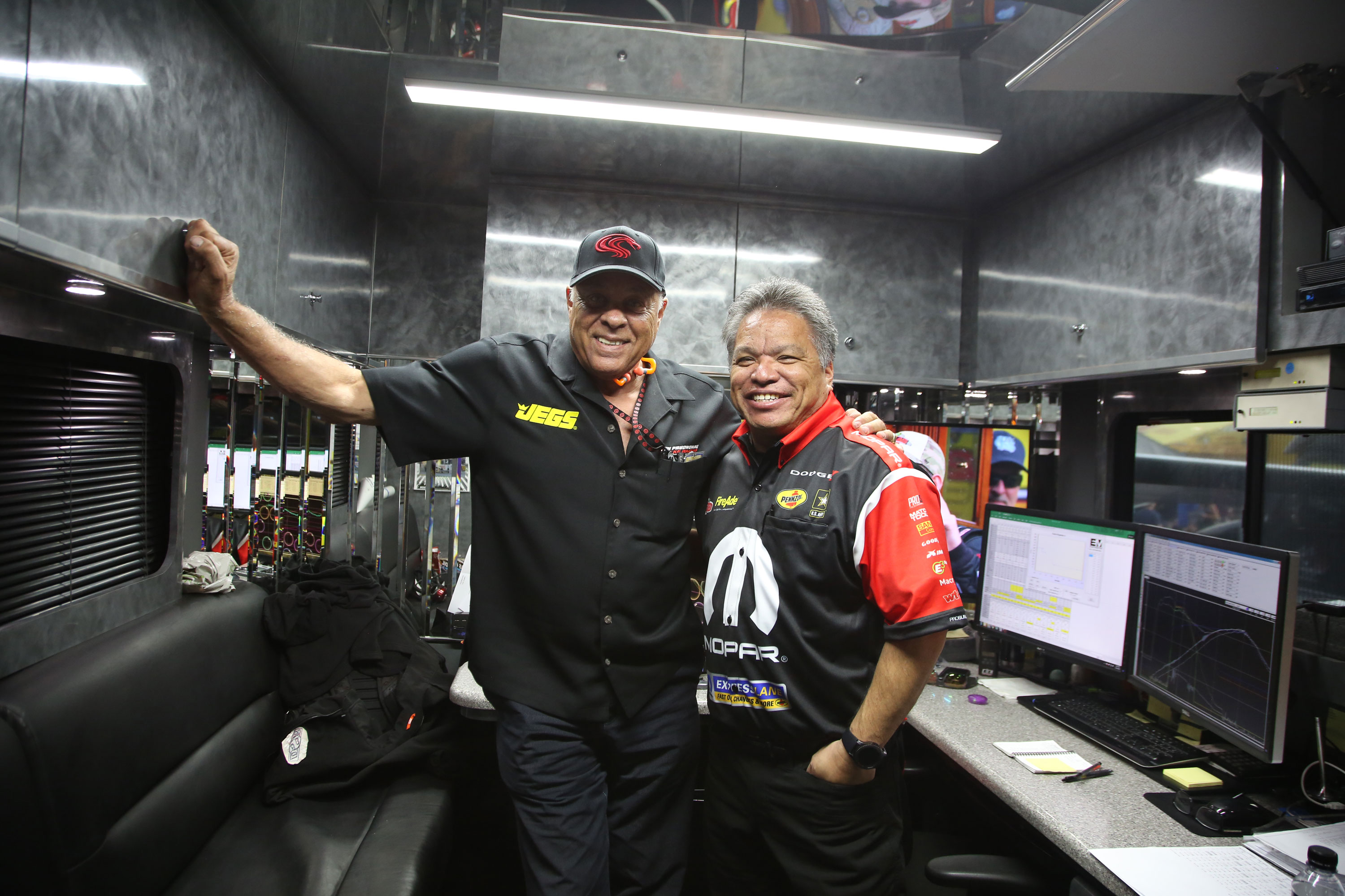 """You'll find former Snake Racing employees all over the pits. Prudhomme poses for a photo with DSR crew chief, Todd Okuhara. """"This guy used to work for me!"""""""